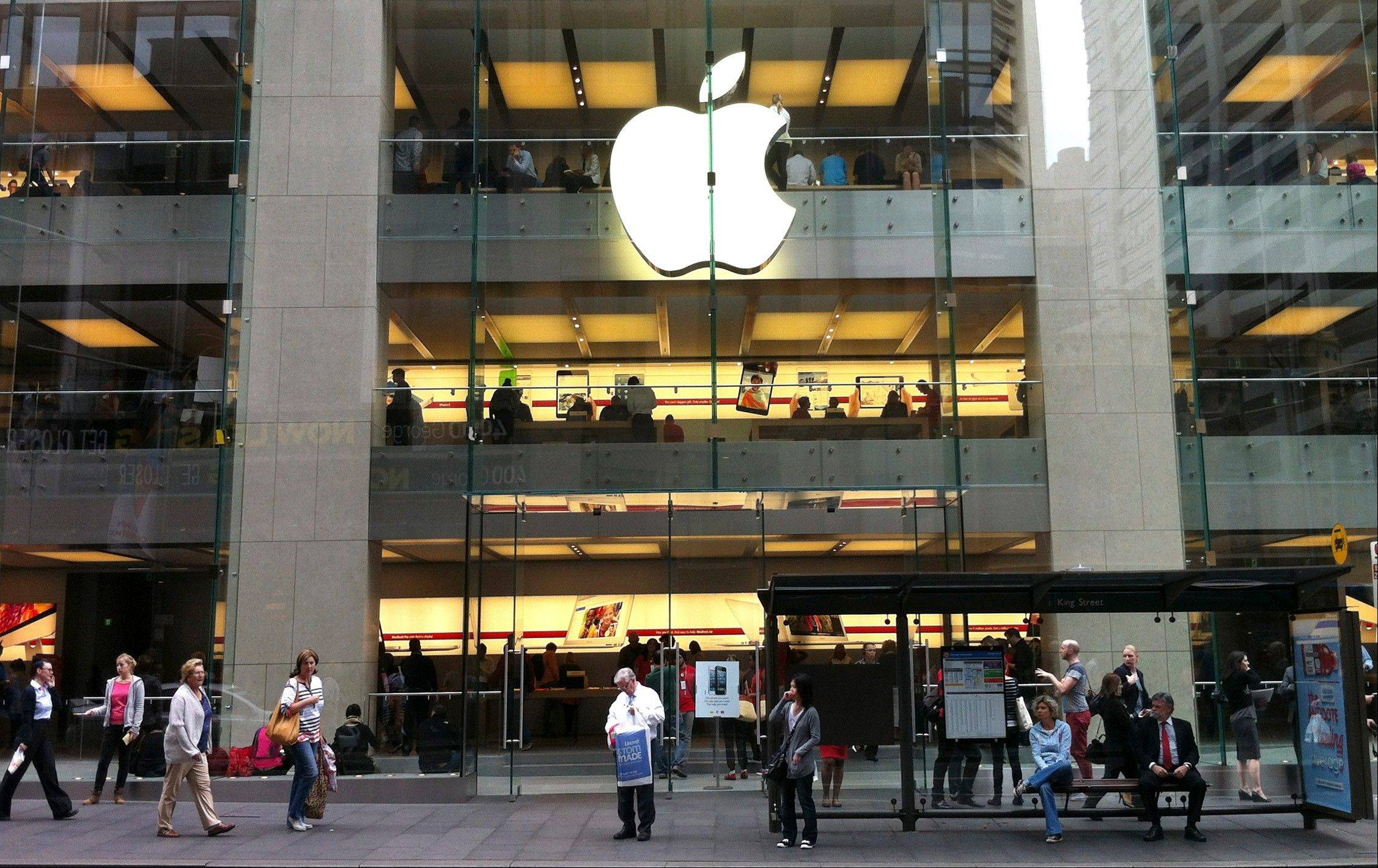 "People walk Tuesday past an Apple store in Sydney's central business district in Australia. Australian police are warning the public that errors in Apple's much-maligned mapping application are leading drivers headed to the southern city of Mildura to take a potentially ""life-threatening"" wrong turn into the middle of a remote state park."