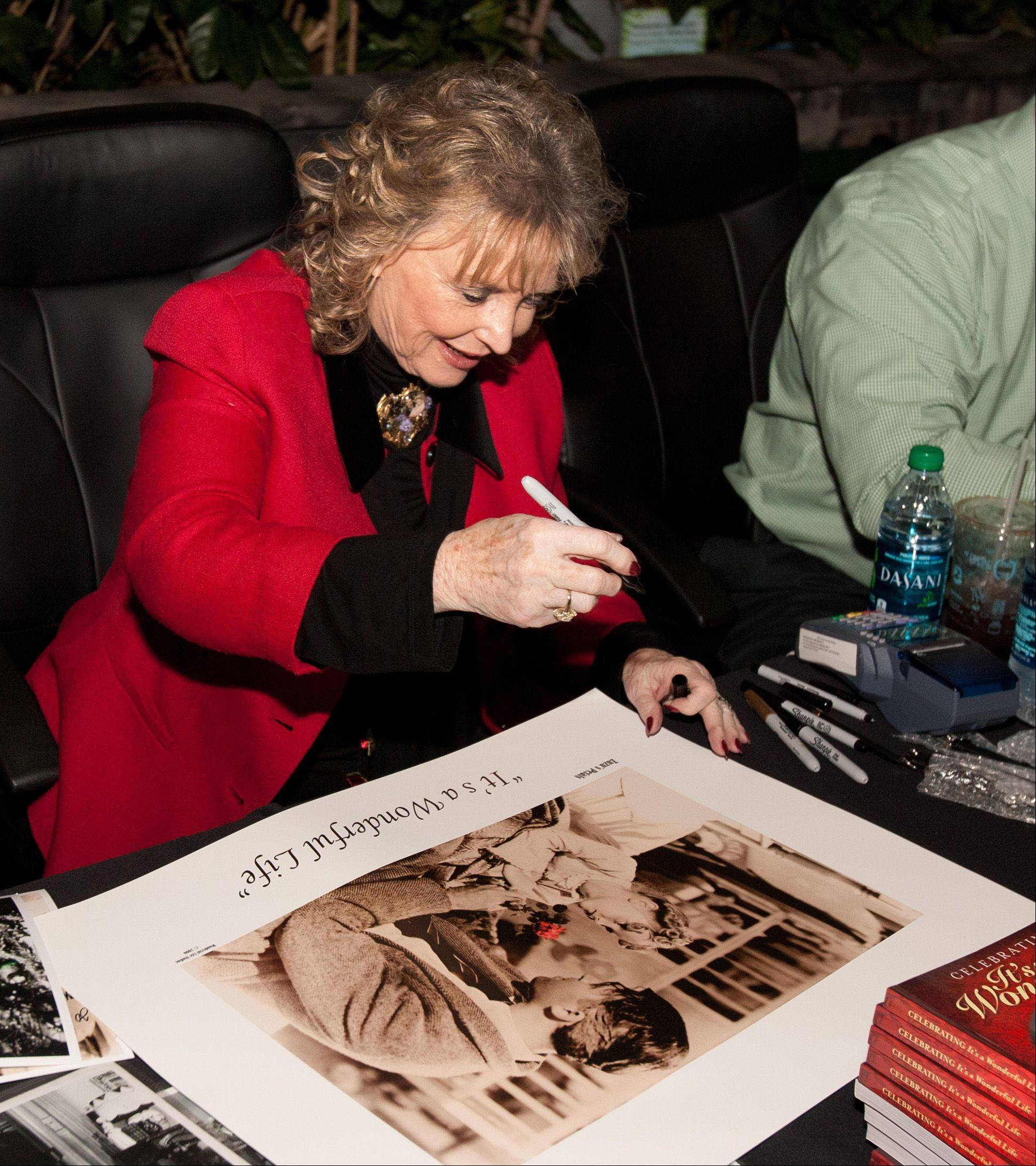 "Karolyn Grimes, who played Jimmy Stewart's daughter Zuzu Bailey in the movie ""It's a Wonderful Life,"" met fans and signed autographs at Hollywood Palms in Naperville."