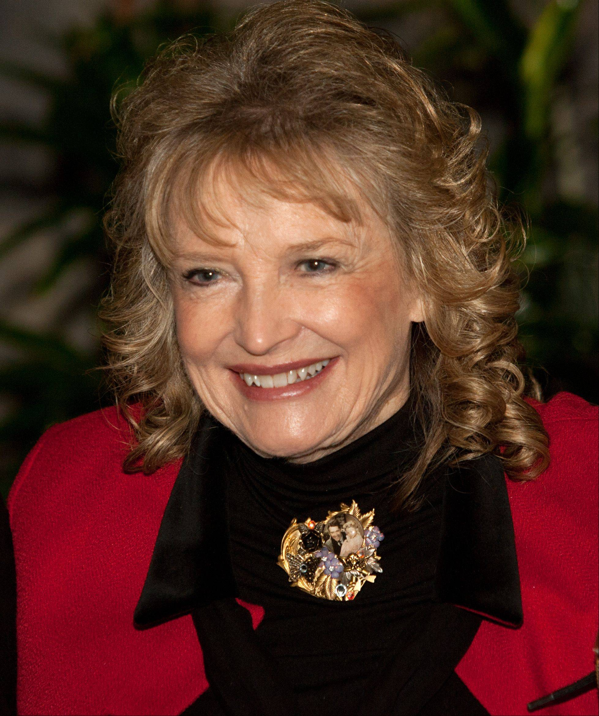 "Karolyn Grimes, who played Jimmy Stewart's daughter Zuzu Bailey in ""It's a Wonderful Life,"" met fans at Hollywood Palms in Naperville."