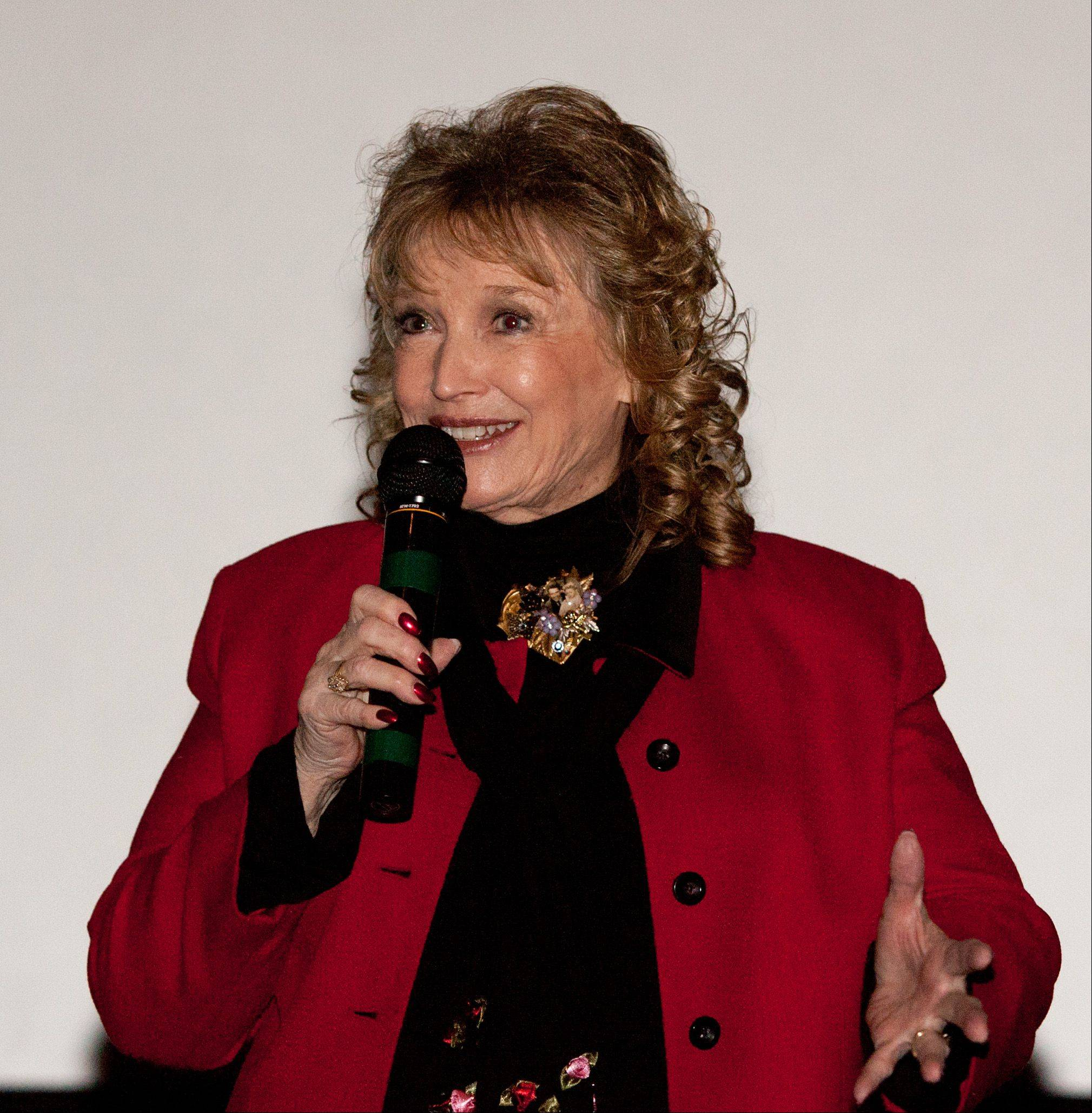 "Karolyn Grimes, who played Jimmy Stewart's daughter Zuzu Bailey in ""It's a Wonderful Life,"" met fans at Hollywood Palms in Naperville. Above, before an afternoon screening, Grimes talks to an audience about her film experiences."