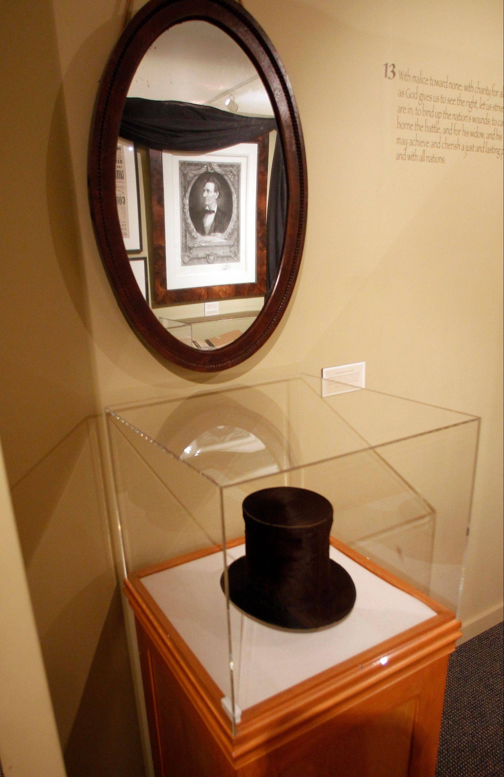 A stove pipe hat and mirror used by Abraham Lincoln is seen at the Robert Todd Lincoln mansion in Manchester, Vt.
