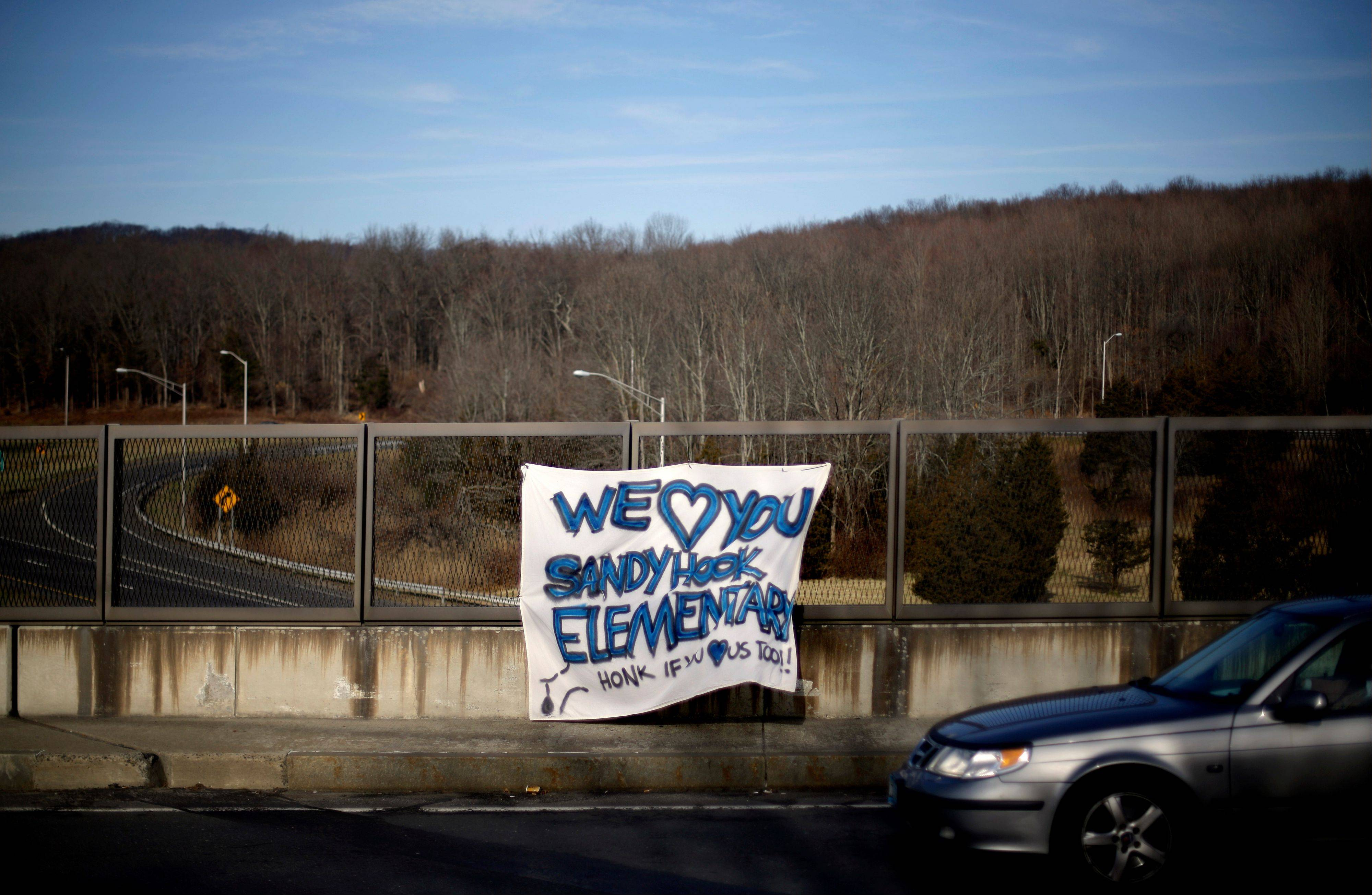 A banner hangs from an overpass Saturday, offering support.