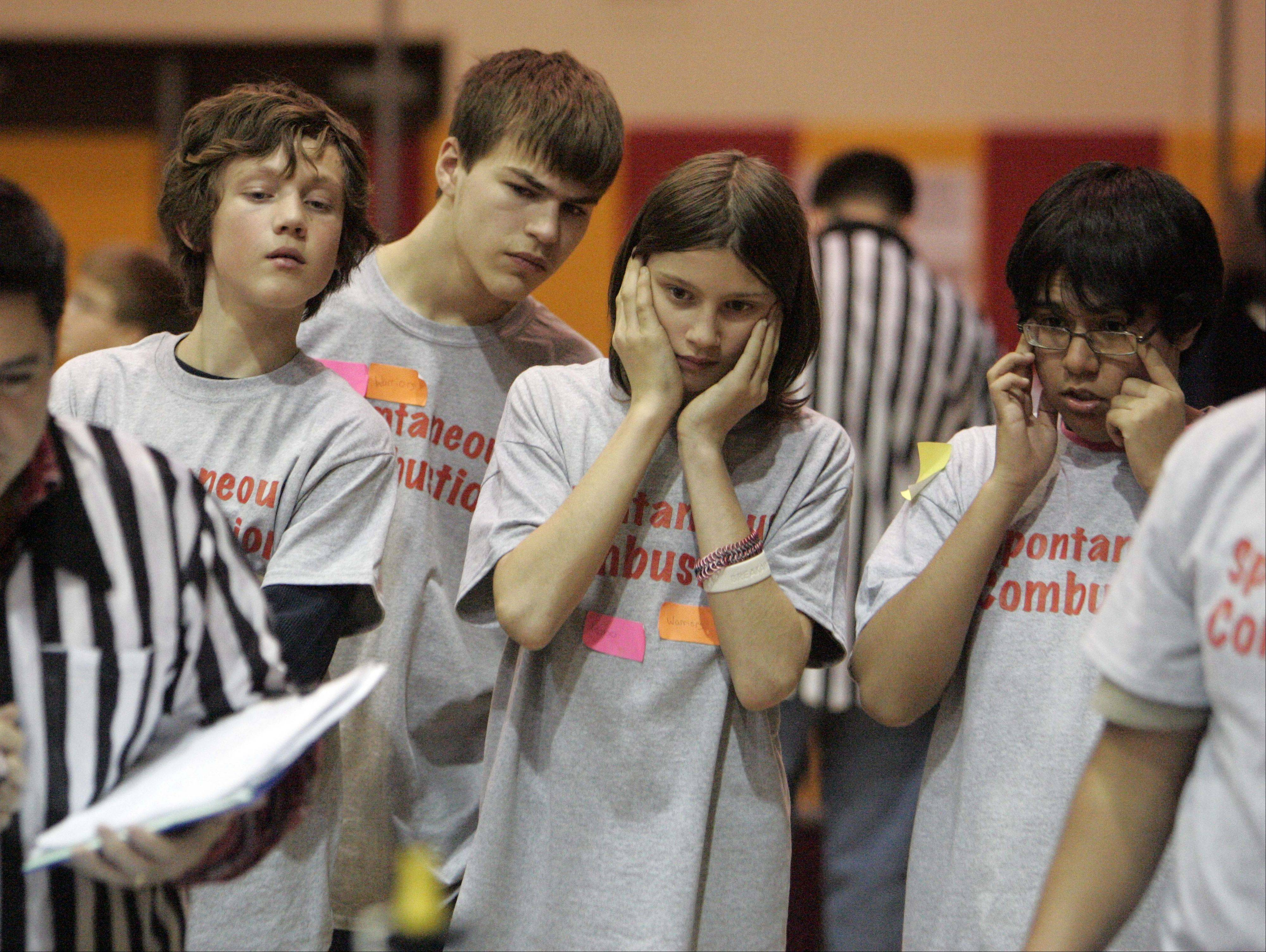 "Elgin's Abbott Middle School team, the Robo Warriors, react as their Lego project tries to accomplish some of the tasks during the FIRST Lego League 2012 ""Super Seniors"" event at Rotolo Middle School in Batavia Saturday."