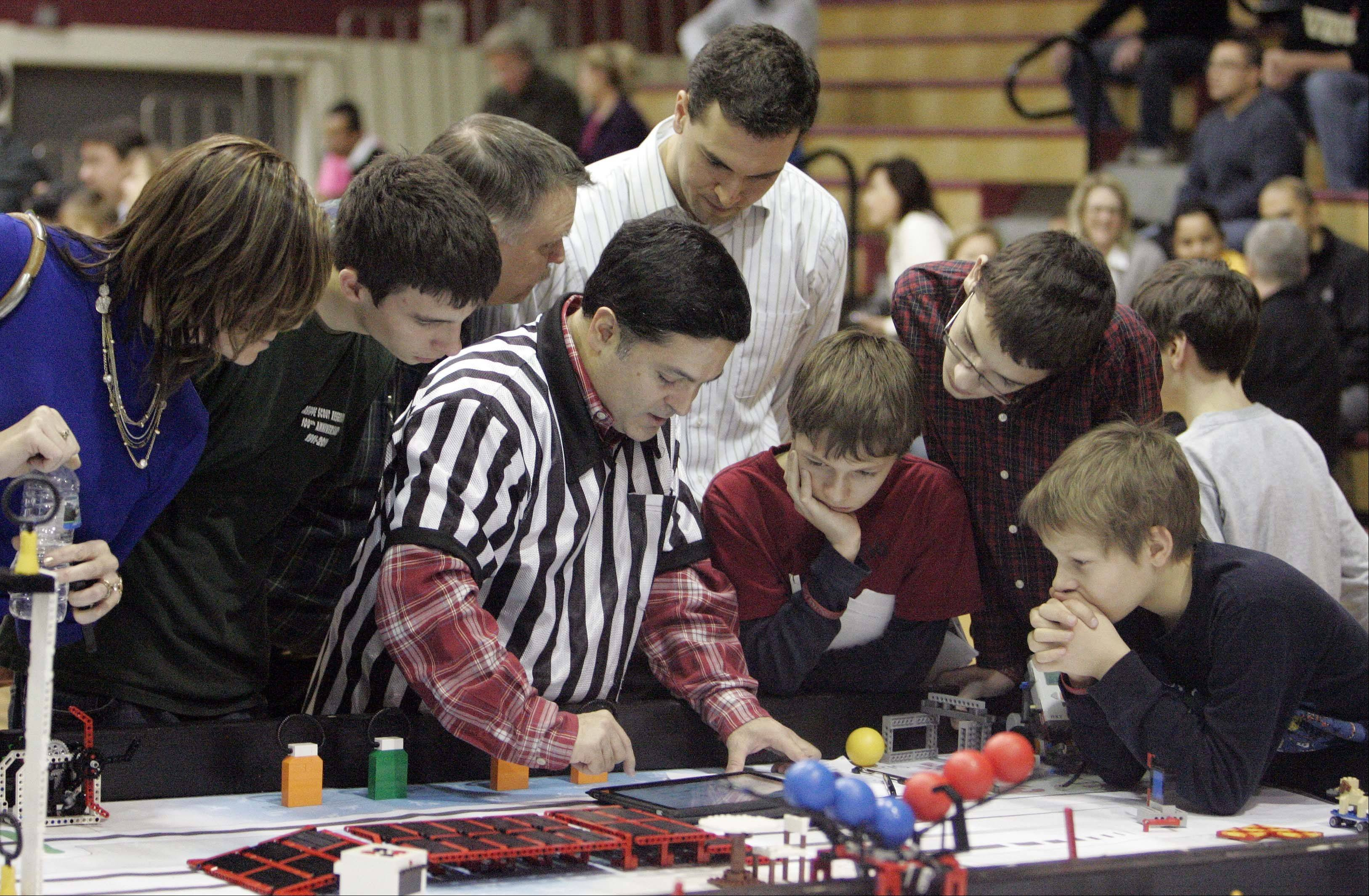 "Referee Chris Frausto explains the scoring during the FIRST Lego League 2012 ""Super Seniors"" event at Rotolo Middle School in Batavia Saturday."