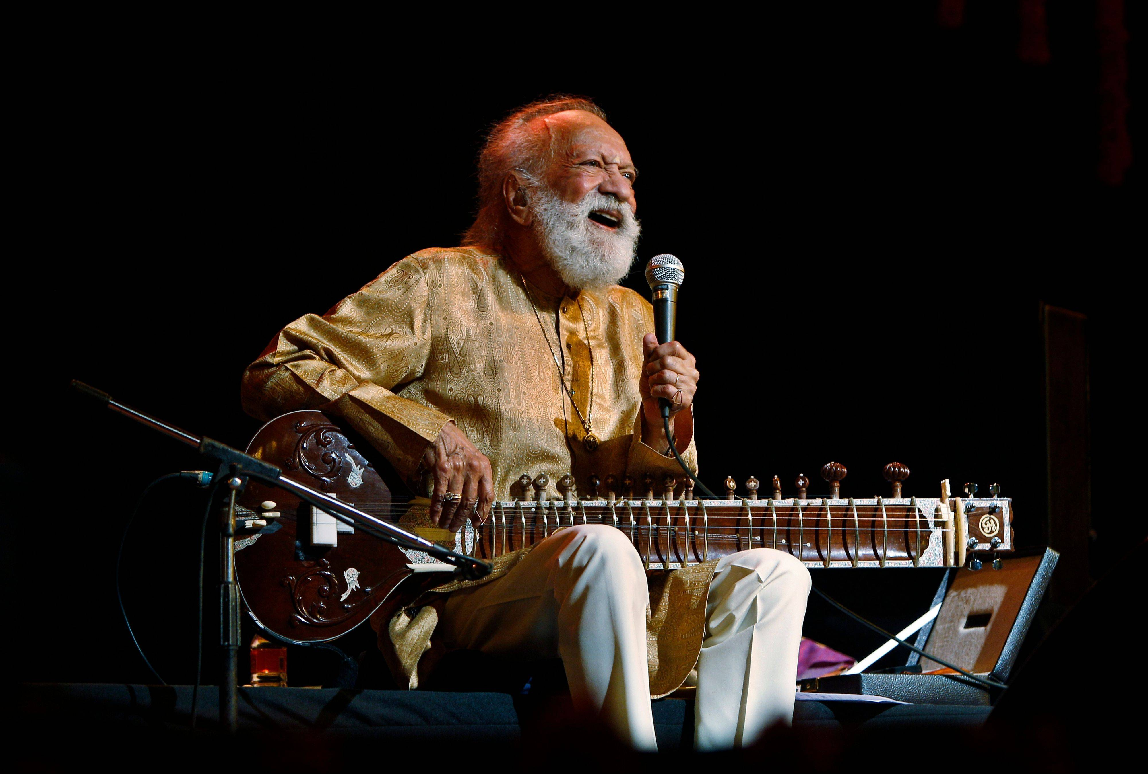 Indian musician Ravi Shankar laughs as he speaks during a concert in Bangalore, India.