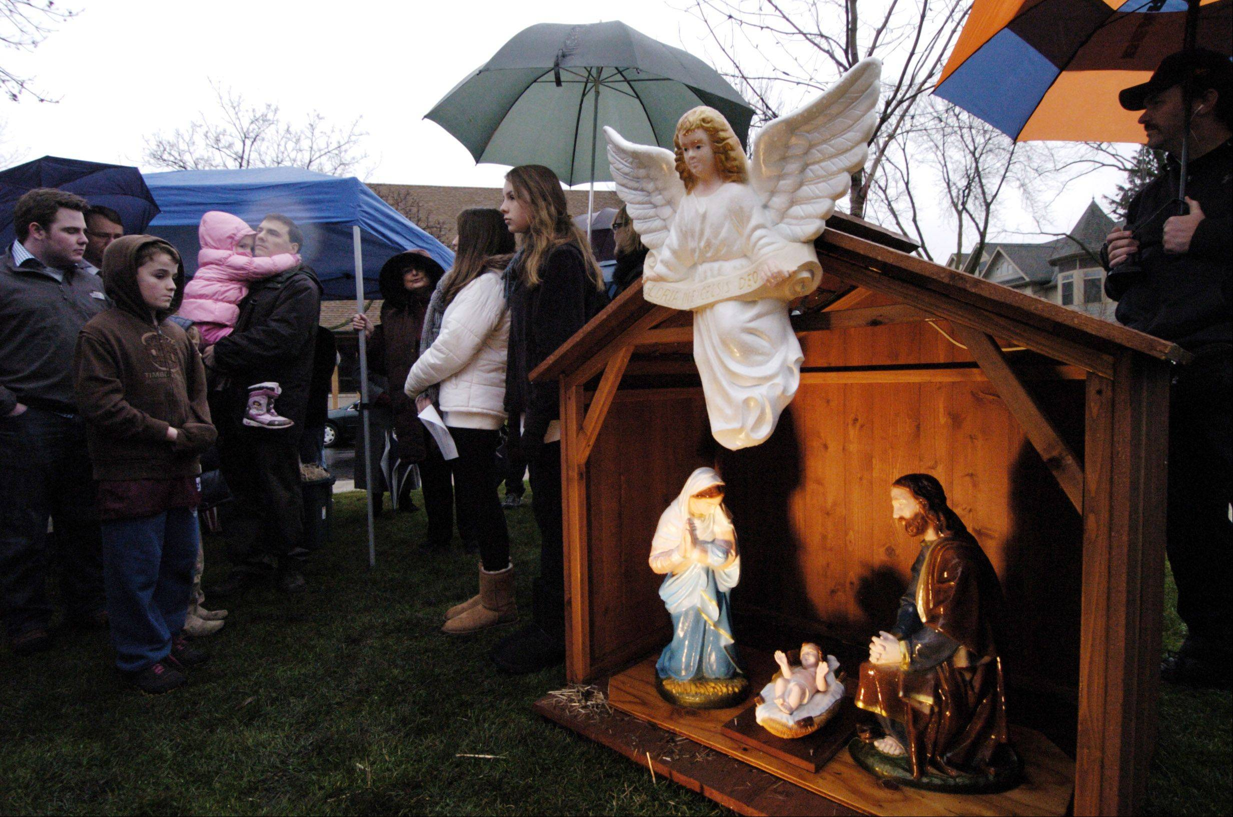 After a few weeks of controversy, a Nativity scene has been added to holiday displays at North School Park in Arlington Heights. Sponsored by the Illinois Nativity Scene Committee, the display is separated from other holiday decorations by a small fence and a sign.