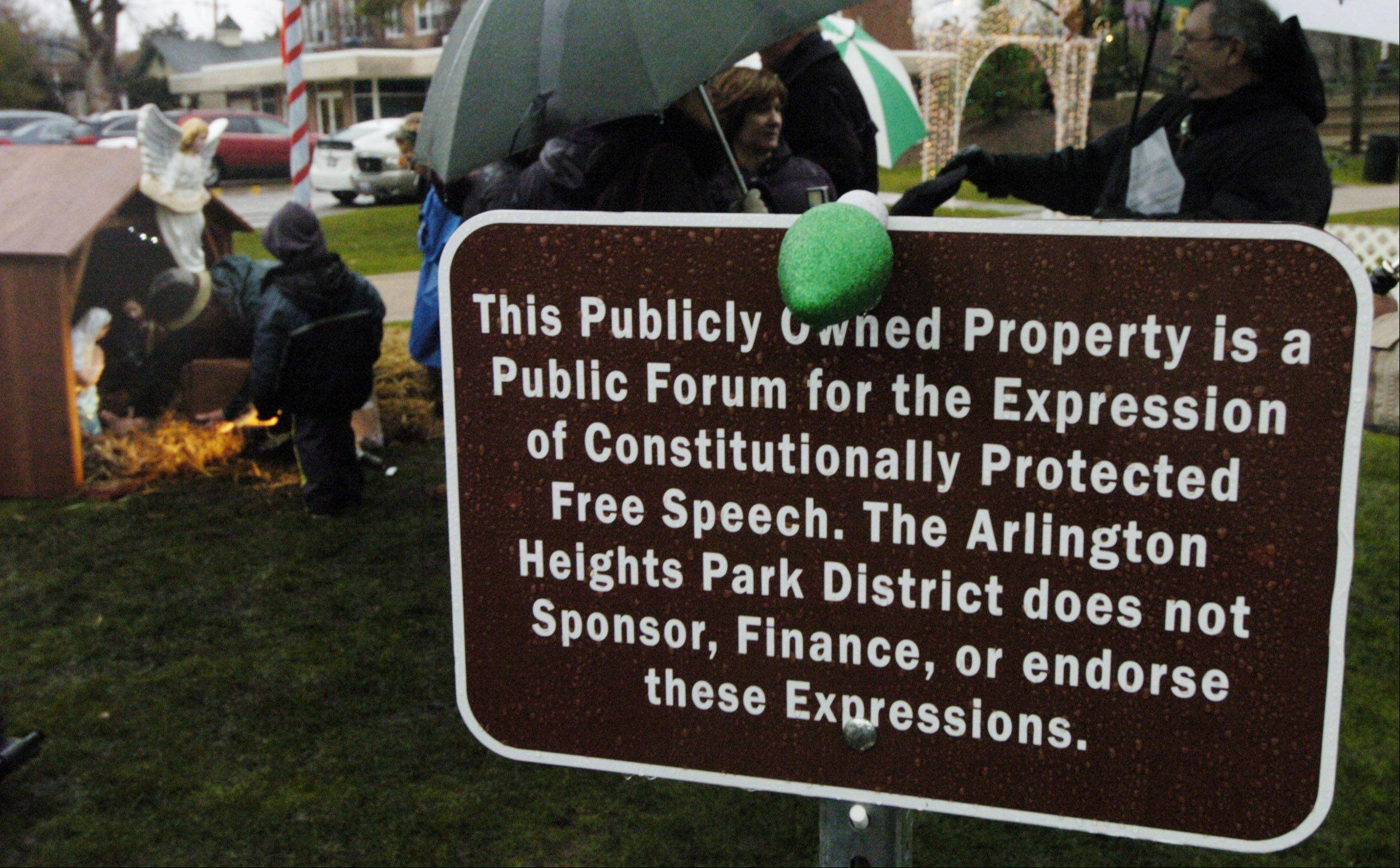 The Arlington Heights Park District placed this sign in near the Nativity scene installed Saturday in North School Park to explain the Illinois Nativity Scene Committee's First Amendment right to display it there separate from other holiday decorations.
