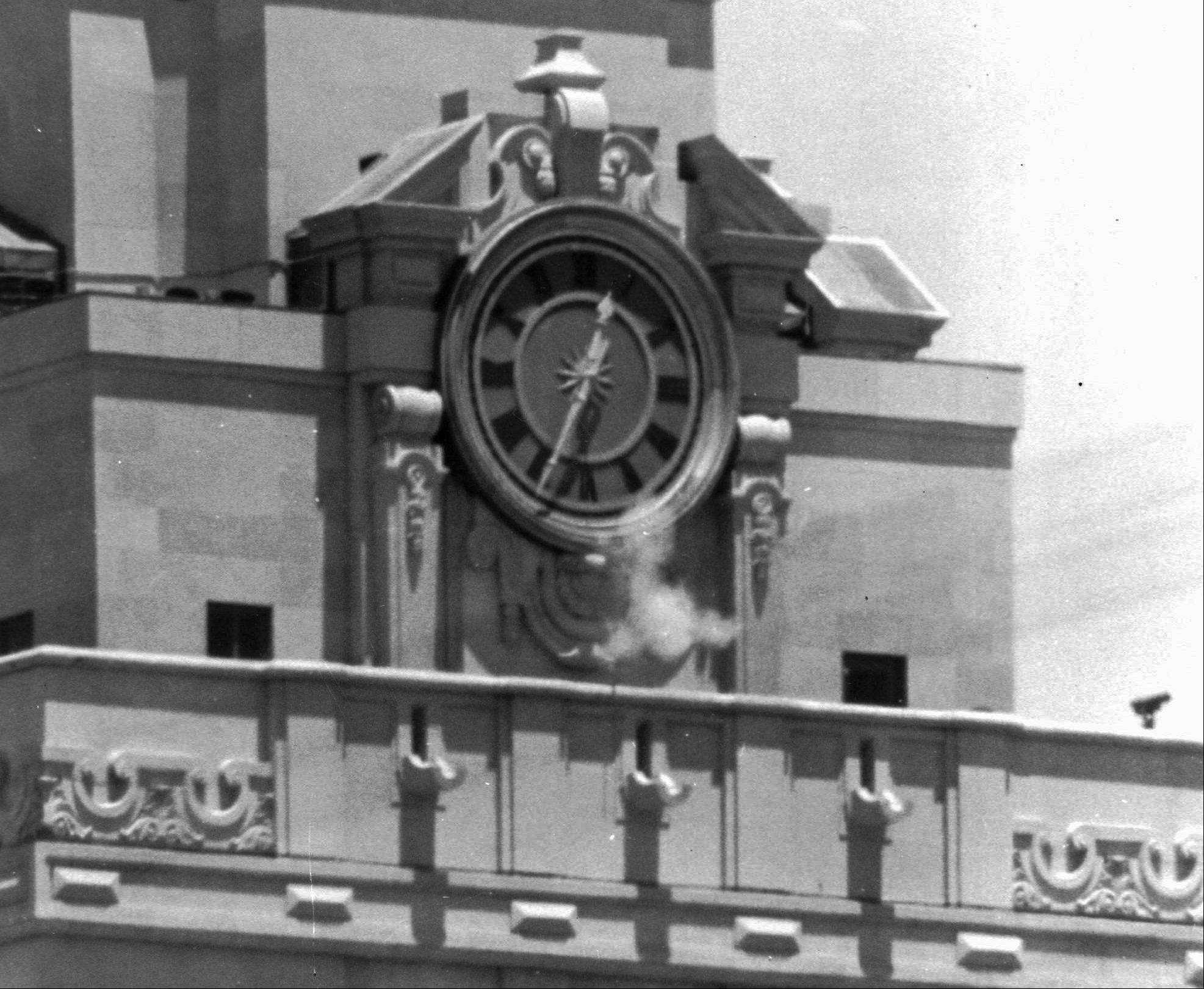 "Smoke rises from a sniper's gun as he fires from the tower of the University of Texas administration building in Austin, Texas at people below. Grant Duwe, a criminologist with the Minnesota Department of Corrections, says, ""Mass shootings provoke instant debates about violence and guns and mental health and that's been the case since Charles Whitman climbed the tower at the University of Texas in 1966."" The engineering student and former Marine killed 13 people and an unborn child and wounded 32 others in the shooting."
