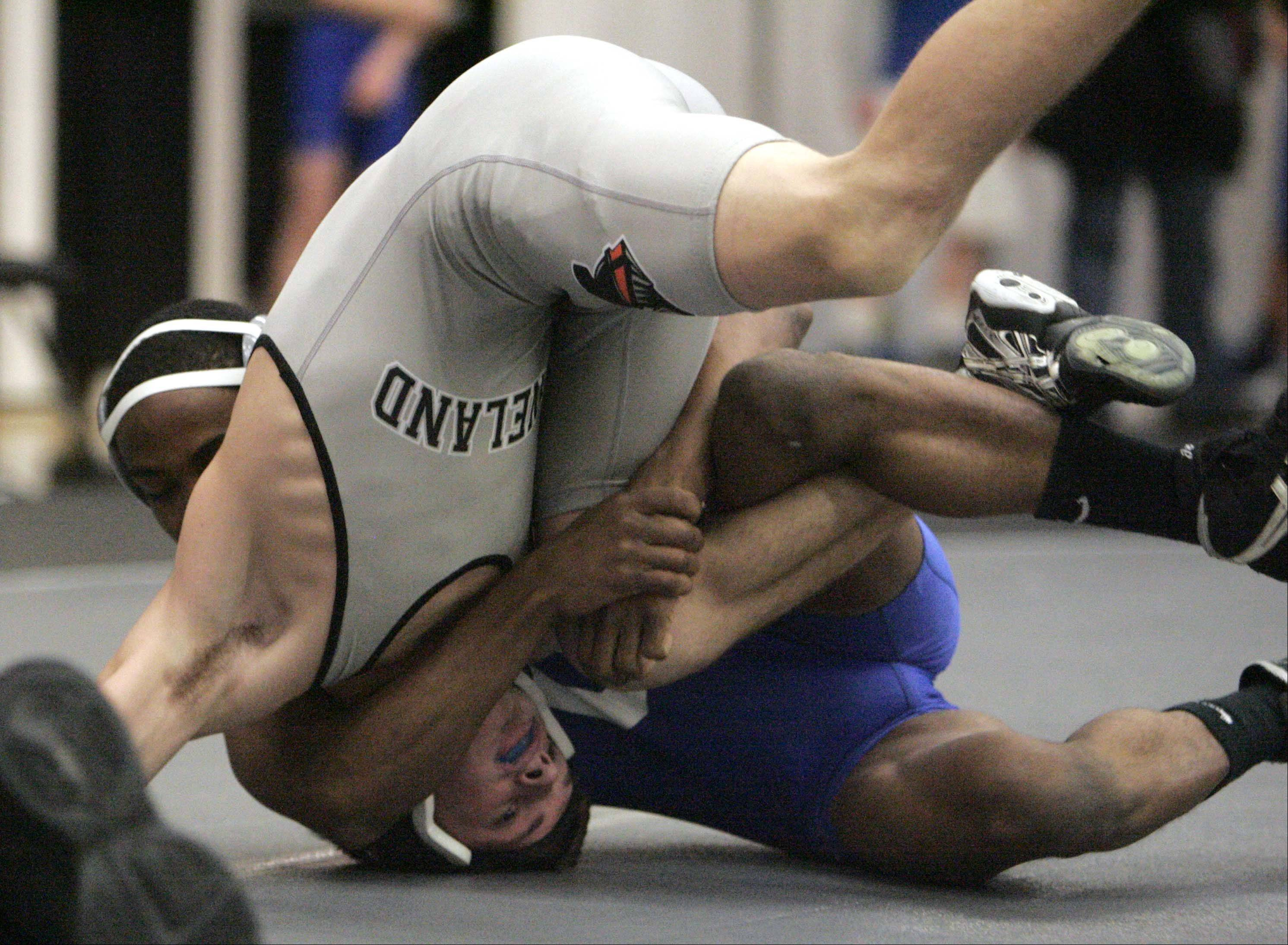 Kanelands's Dane Goodenuf wrestles Geneva's Keehan Freeman at 126 pounds during the Kaneland wrestling quad at Saturday December 15, 2012. Goodenuf won the match.