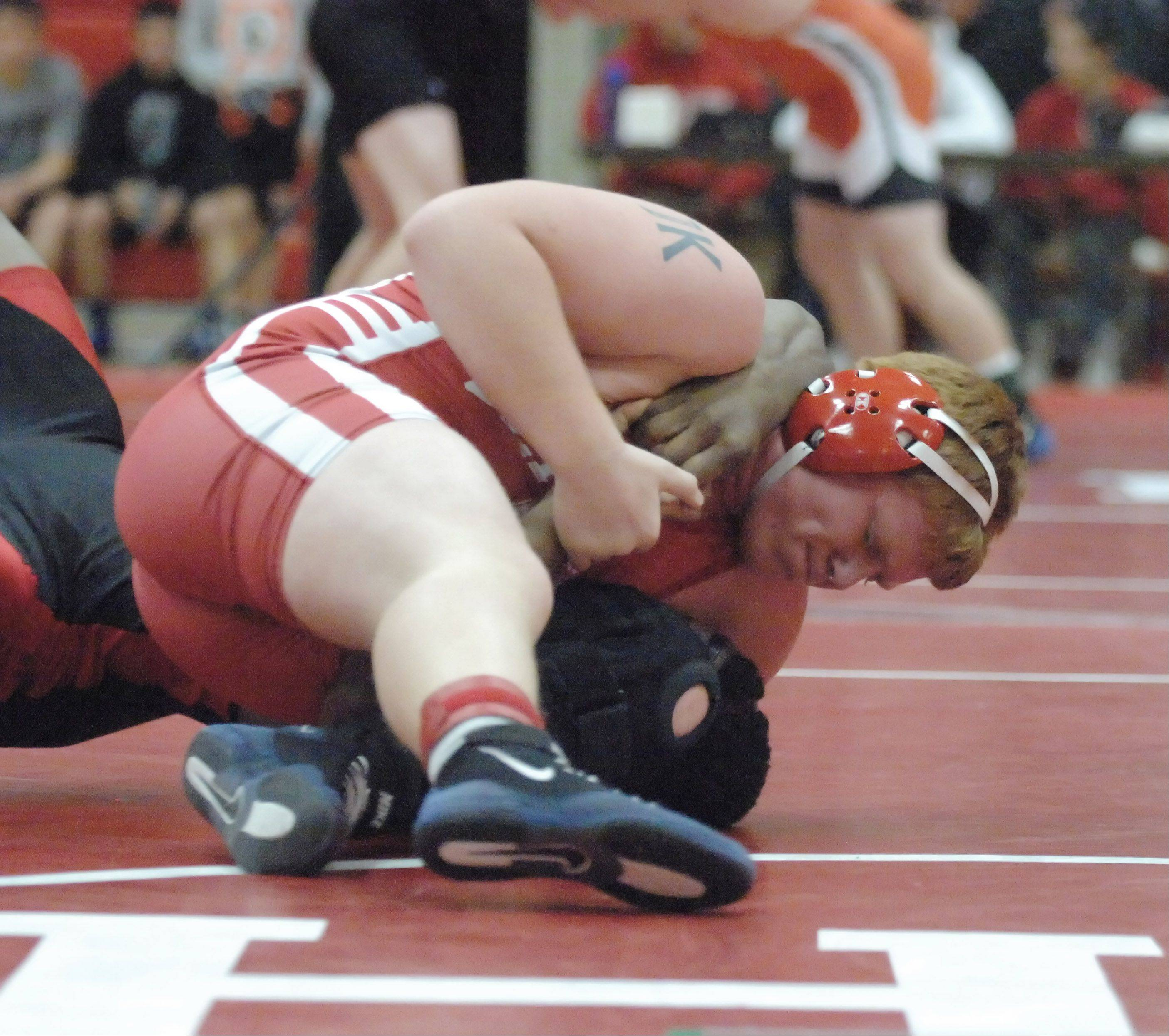 Paul Michna/pmichna@dailyherald.comJustin Tardy of Naperville Central,top, and Taben Miller of Proviso West take part in a 182 lbs. match during the Hinsdale Central wrestling invitational Saturday.