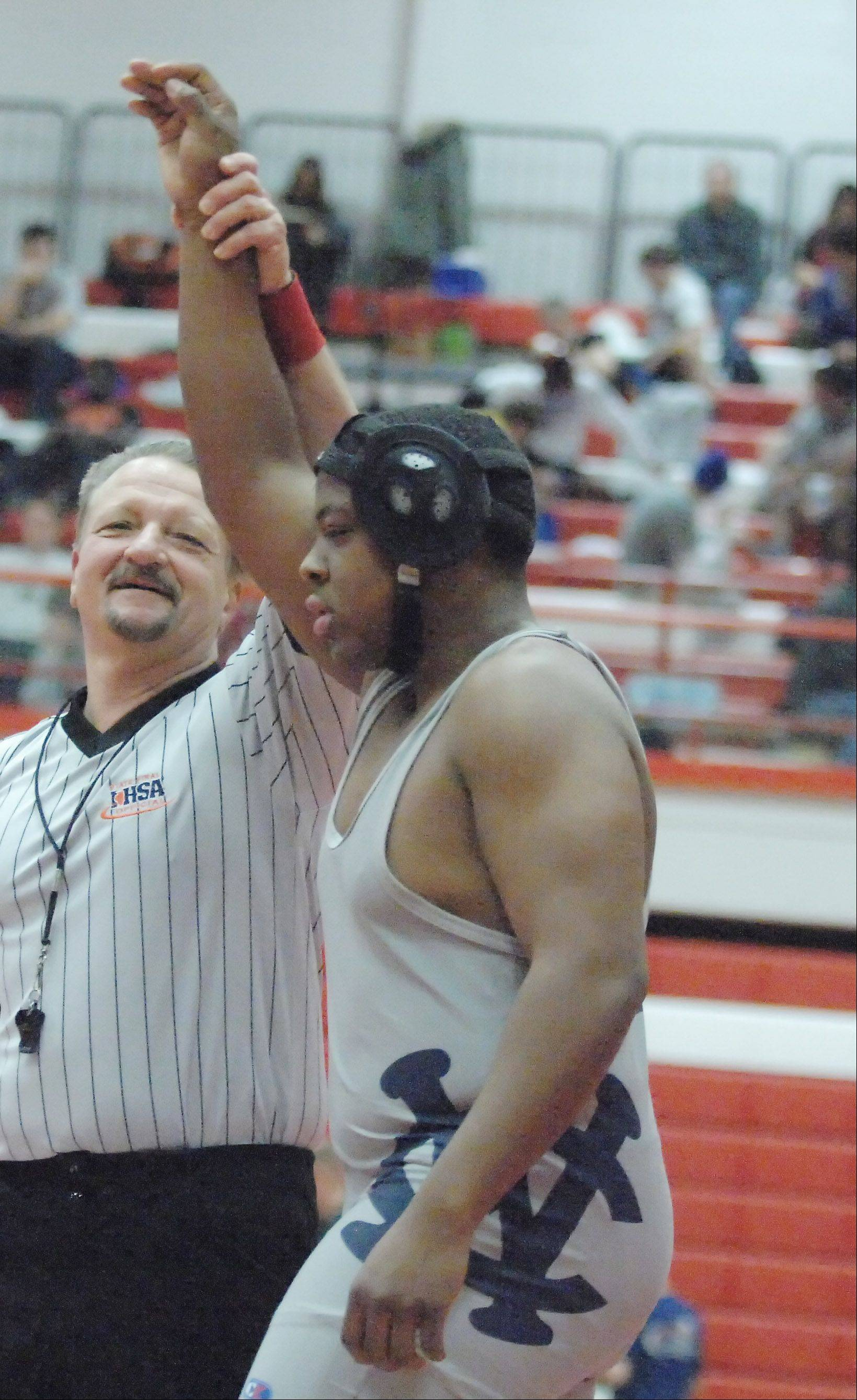 Demetrius Simmons wins a 220 lbs. match during the Hinsdale Central wrestling invitational Saturday. He is from West Chicago.