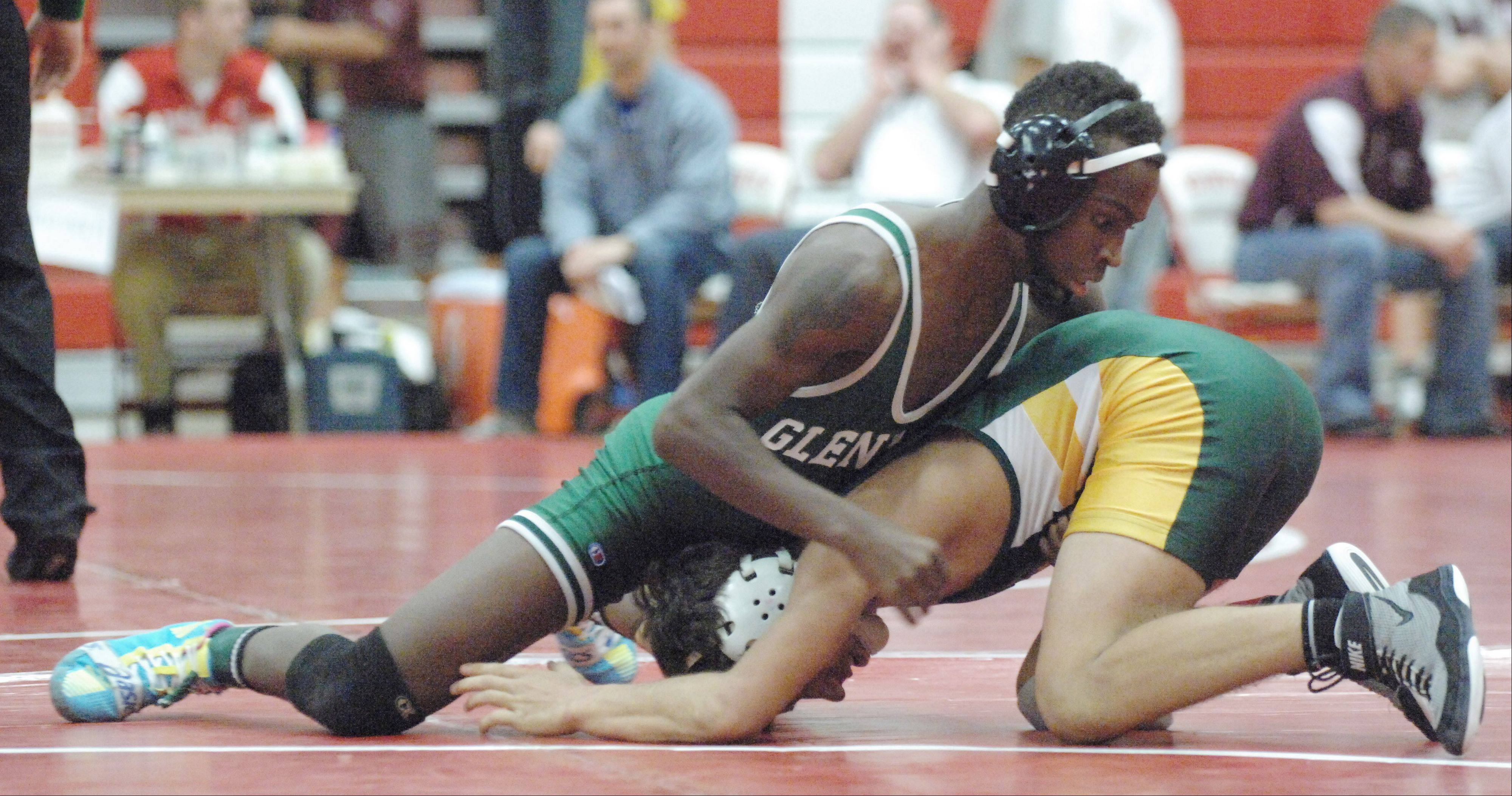 Pernevlon Sheppard of Glenbard West,left, and Danny Carlson of Lane take part in the 126 lbs. match during the Hinsdale Central wrestling invitational Saturday.