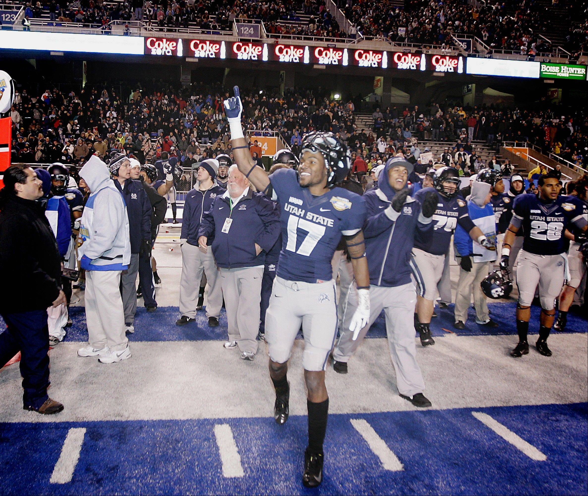 Utah State's Jeff Maning (17) celebrates Saturday after defeating Toledo 41-15 in the Famous Idaho Potato Bowl.
