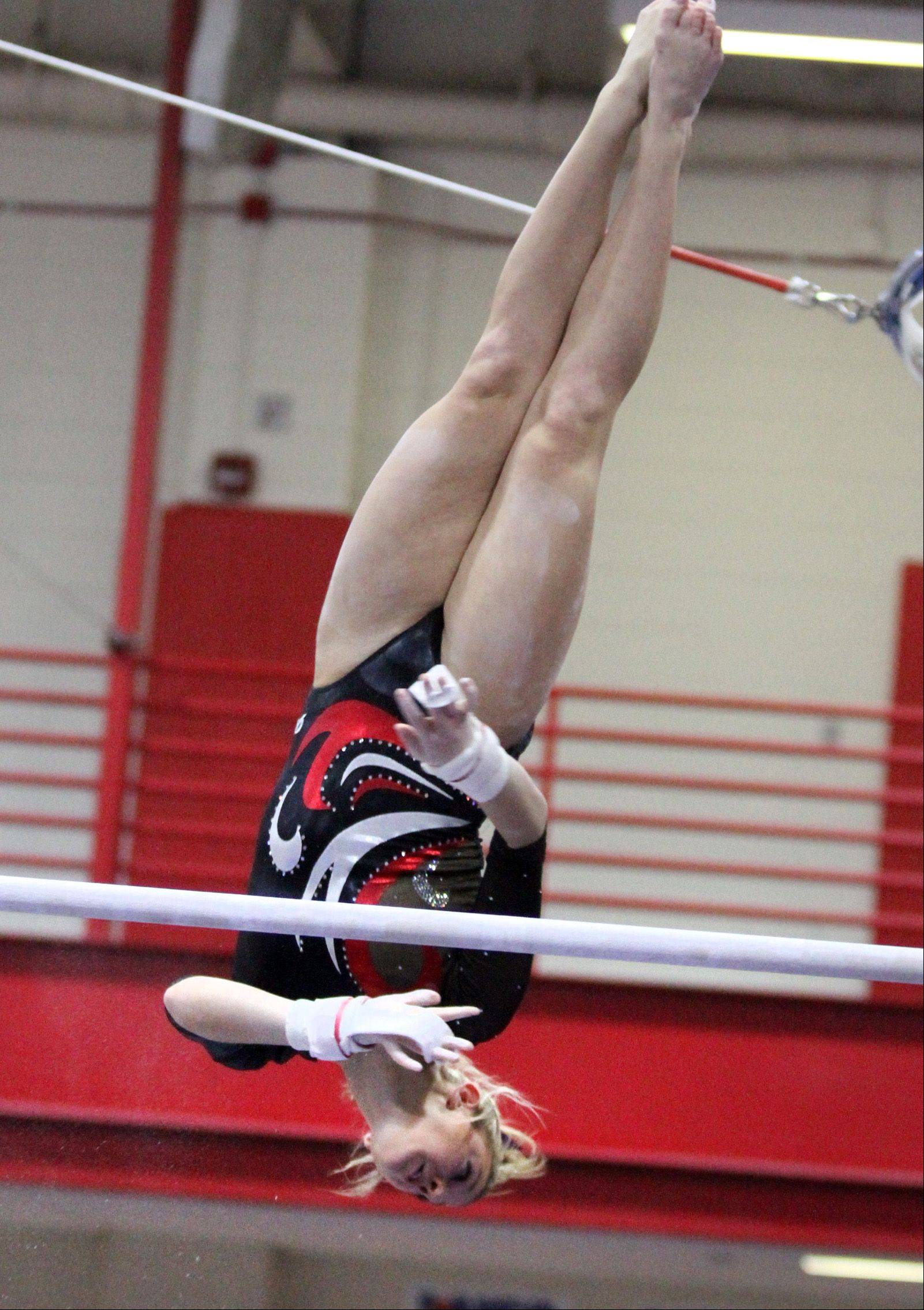 Palatine's Abby Alden competes on the uneven parallel bars at the Palatine invitational on Saturday.