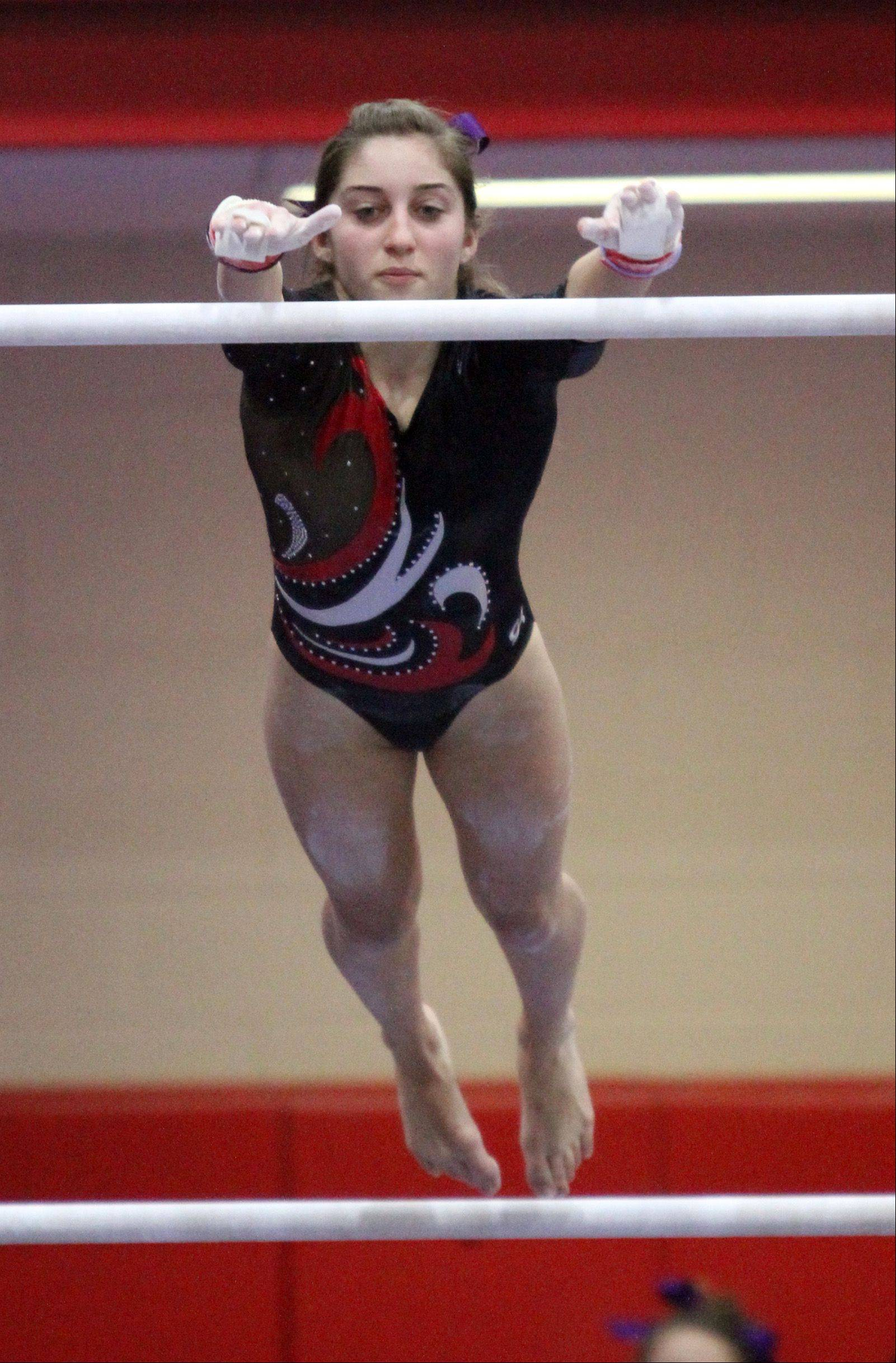 Palatine's Claudia Przystal competes on the uneven parallel bars at the Palatine invitational on Saturday.
