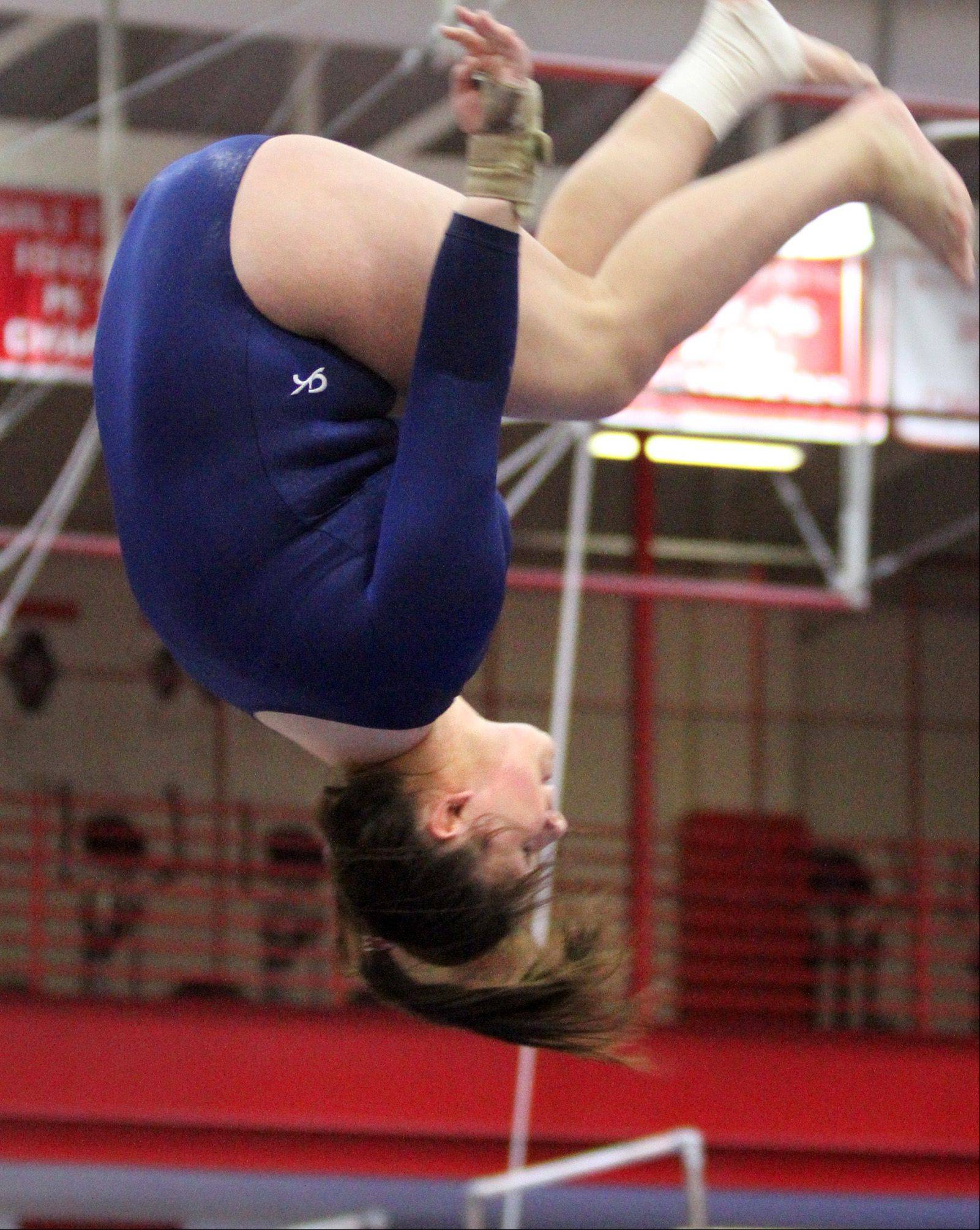 Megan Barnes with Bartlett/South Elgin (Coop) competes on the balance beam at the Palatine invitational on Saturday.