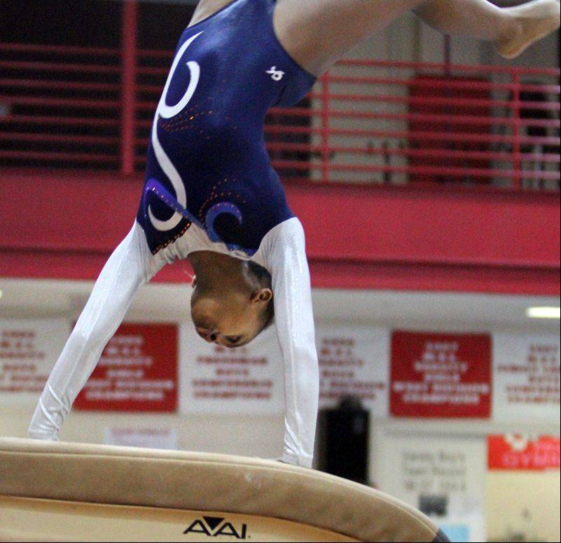 Shelby Porter of Naperville North competes on vault at the Palatine invitational on Saturday.