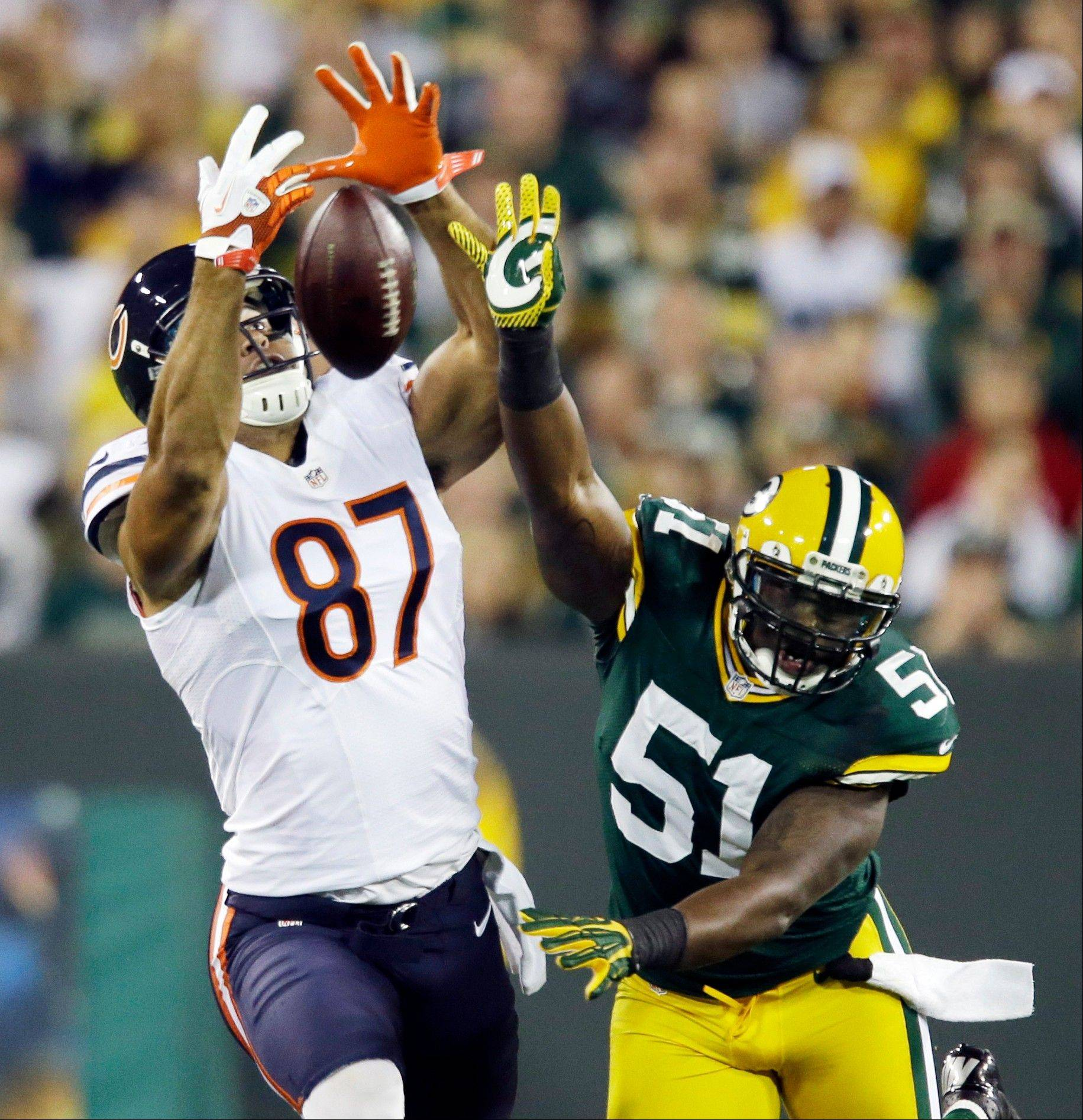 Green Bay Packers' D.J. Smith (51) breaks up a pass intended for the Bears' Kellen Davis (87) during the first half earlier this season in Green Bay, Wis.