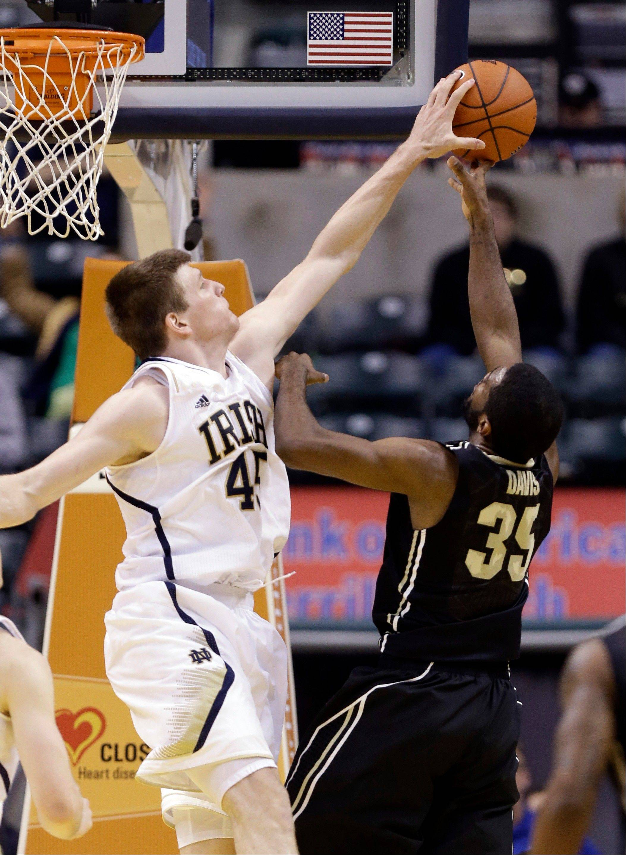 Notre Dame forward Jack Cooley, left, blocks the shot of Purdue guard Rapheal Davis Saturday during the second half in Indianapolis. Notre Dame defeated Purdue 81-68.