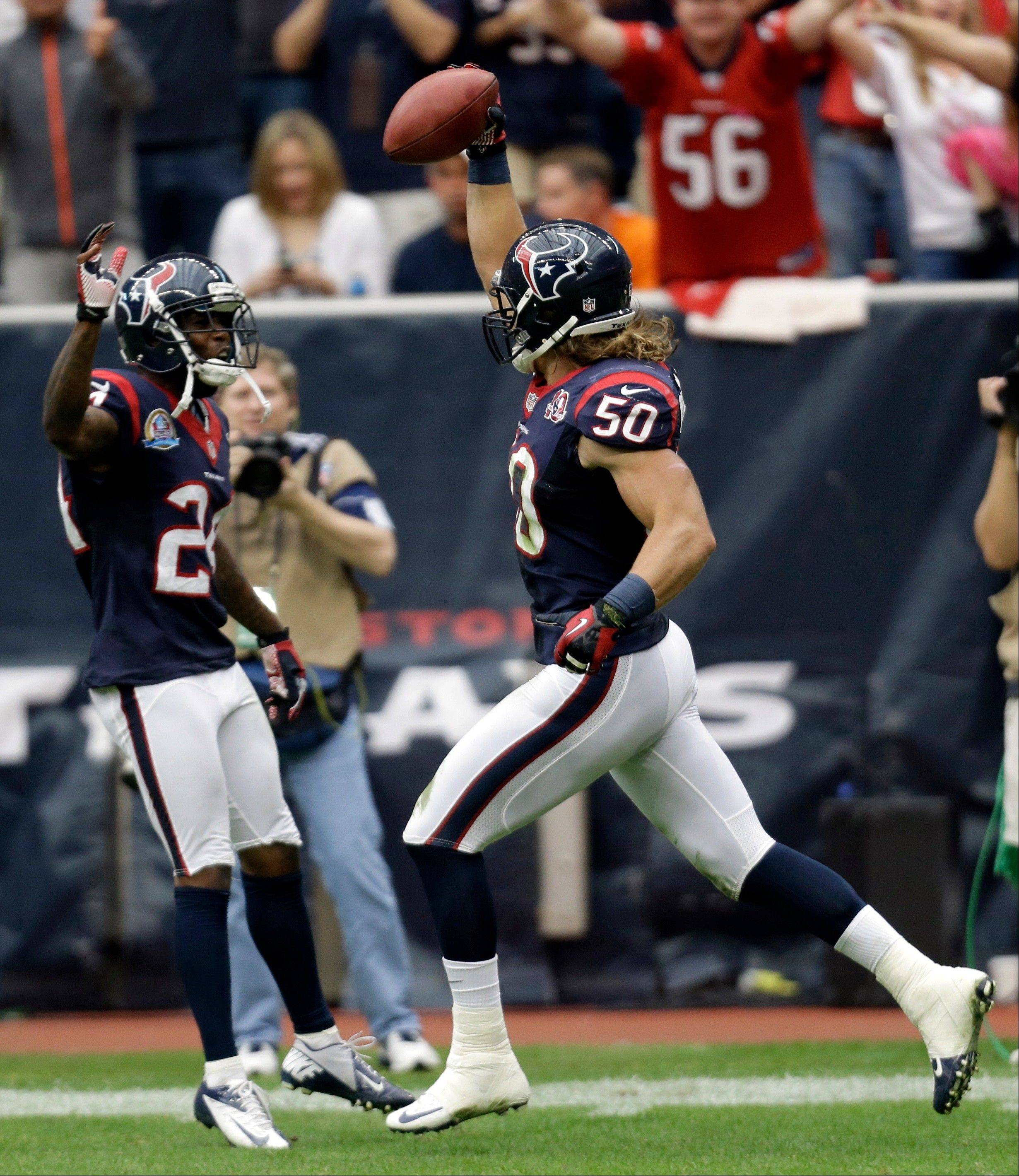 Houston Texans linebacker Bryan Braman (50) celebrates with Johnathan Joseph, left, after blocking a punt and returning it for a touchdown in the second quarter against the Indianapolis Colts, Sunday, in Houston.