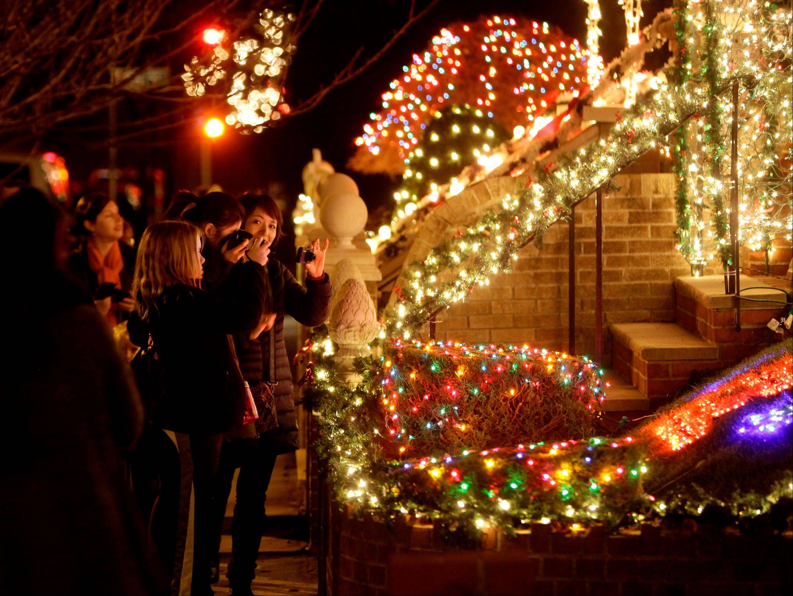 Spectators view an elaborately decorated home for the holidays in the Brooklyn.