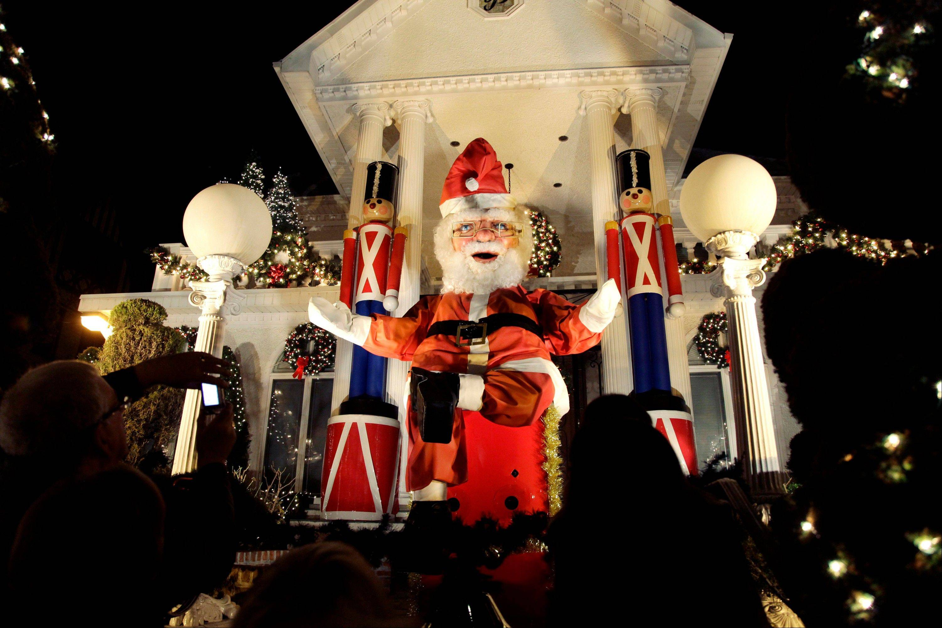 A giant Santa Claus decorates a home in Brooklyn.