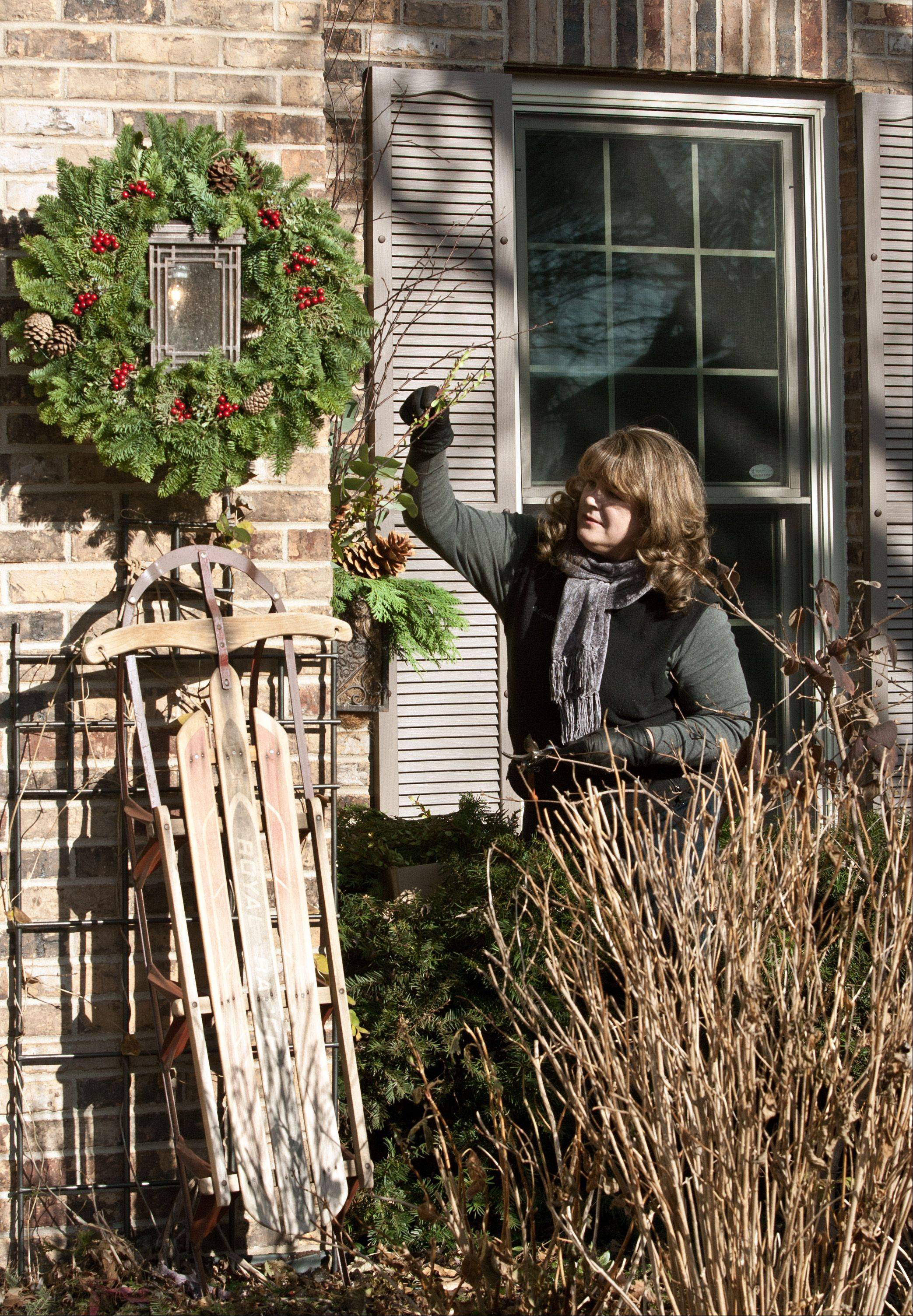 Laura Christensen, a Wheaton landscape architect, has completely transformed her yard and shares her techniques with garden clubs in the area.