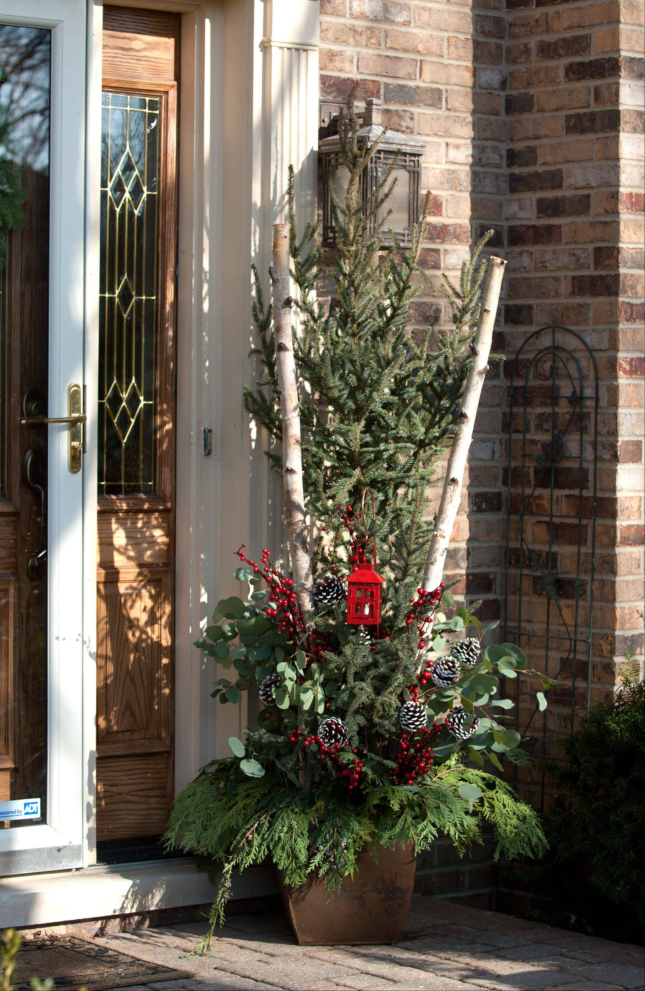 Christensen worked on plenty of seasonal containers for customers this holiday season. Her tip? Combine textures for varied interest. Here is the container she put together for her front porch.