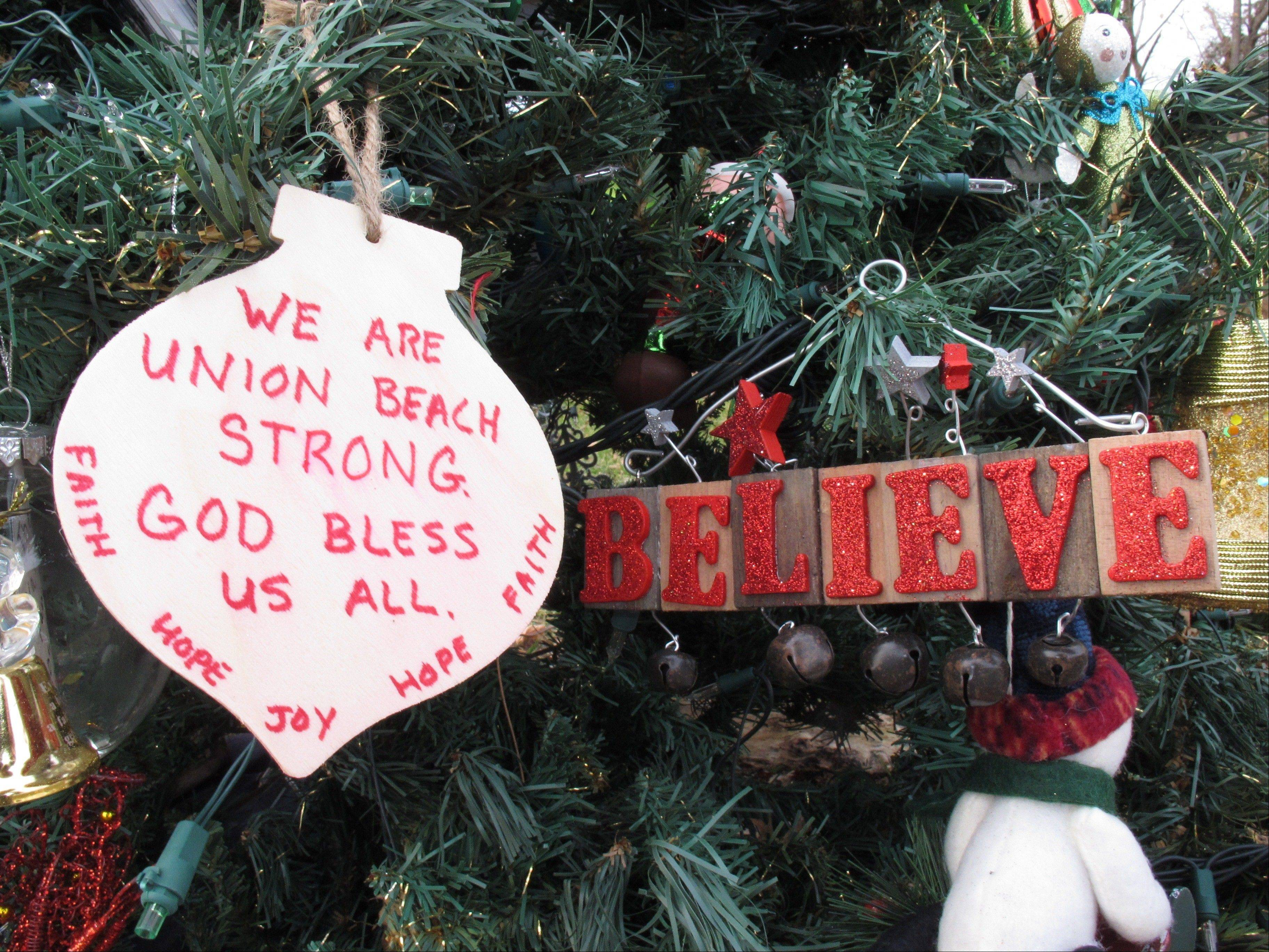 "A handmade ornament adorns the ""Tree Of Hope,"" in Union Beach, N.J. The artificial Christmas tree was fished from the gutter following Superstorm Sandy, and the town has made it a rallying point amid the storm's devastation."