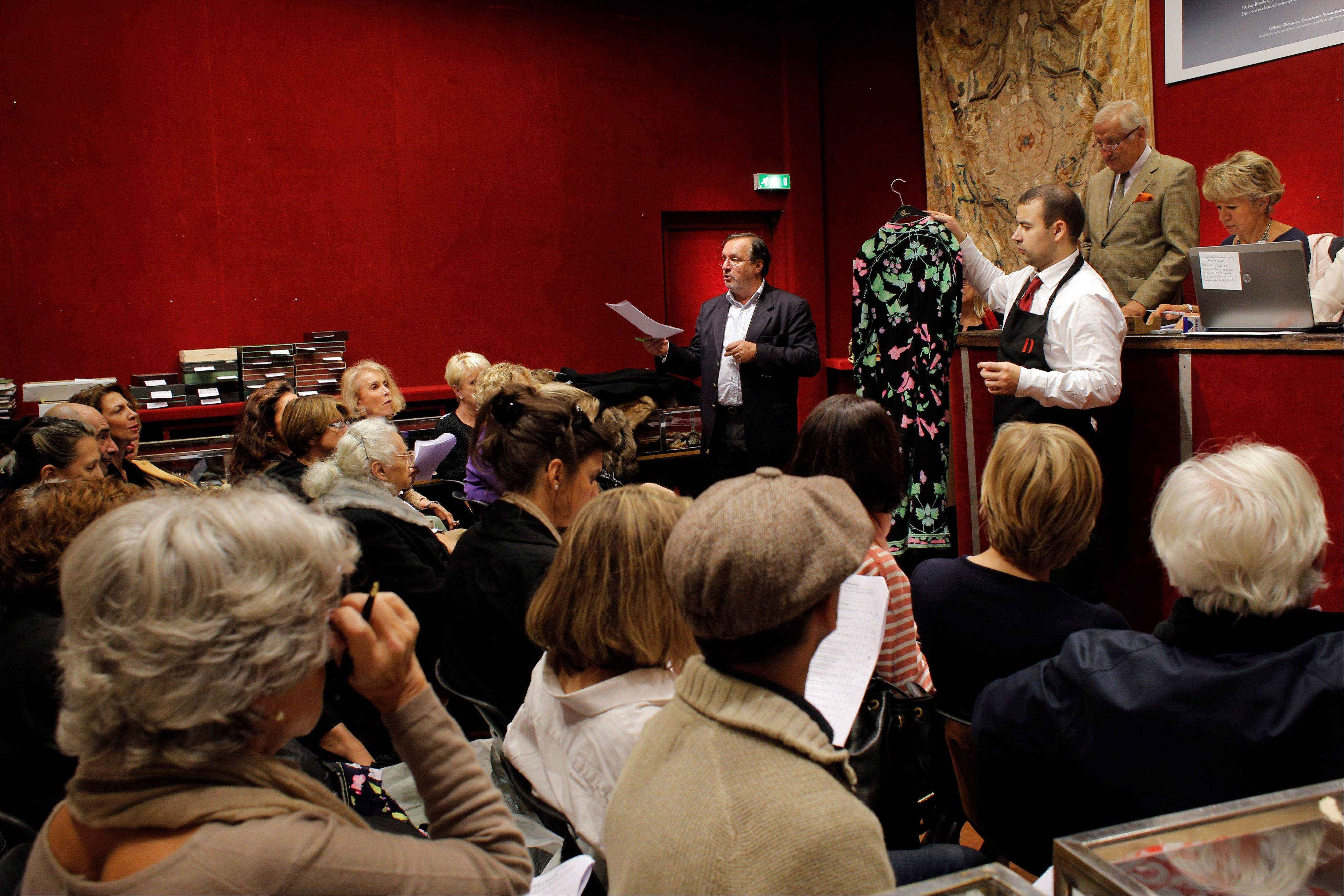 An auction officer sells clothes at the Drouot auction's house, in Paris. The famous auction house in Paris offers 16 functioning auctions rooms and is the world's largest auction house open to the public.