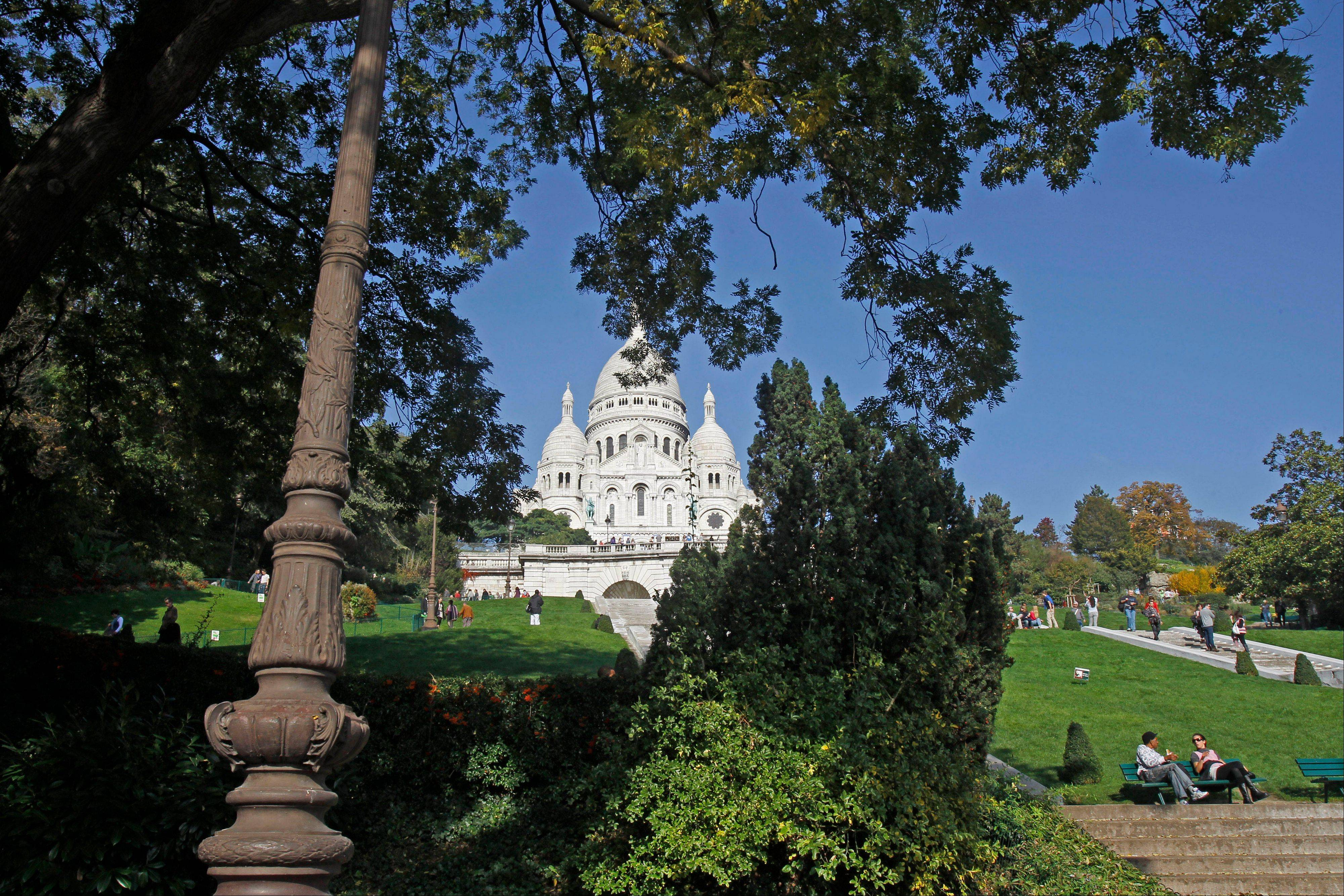 The Sacre Coeur basilica, in Pari is a The landmark white domes of this basilica indelibly mark the Paris skyline, located at the city's highest point on the Montmartre hill and features the world's largest apsis mosaic designed by Luc-Olivier Merson.