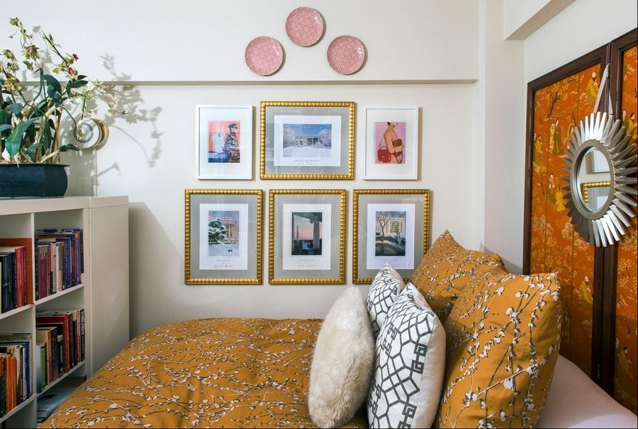 Freeman created a bedroom niche using an Ikea bookcase as a room divider; her headboard is a vintage Chinese screen.