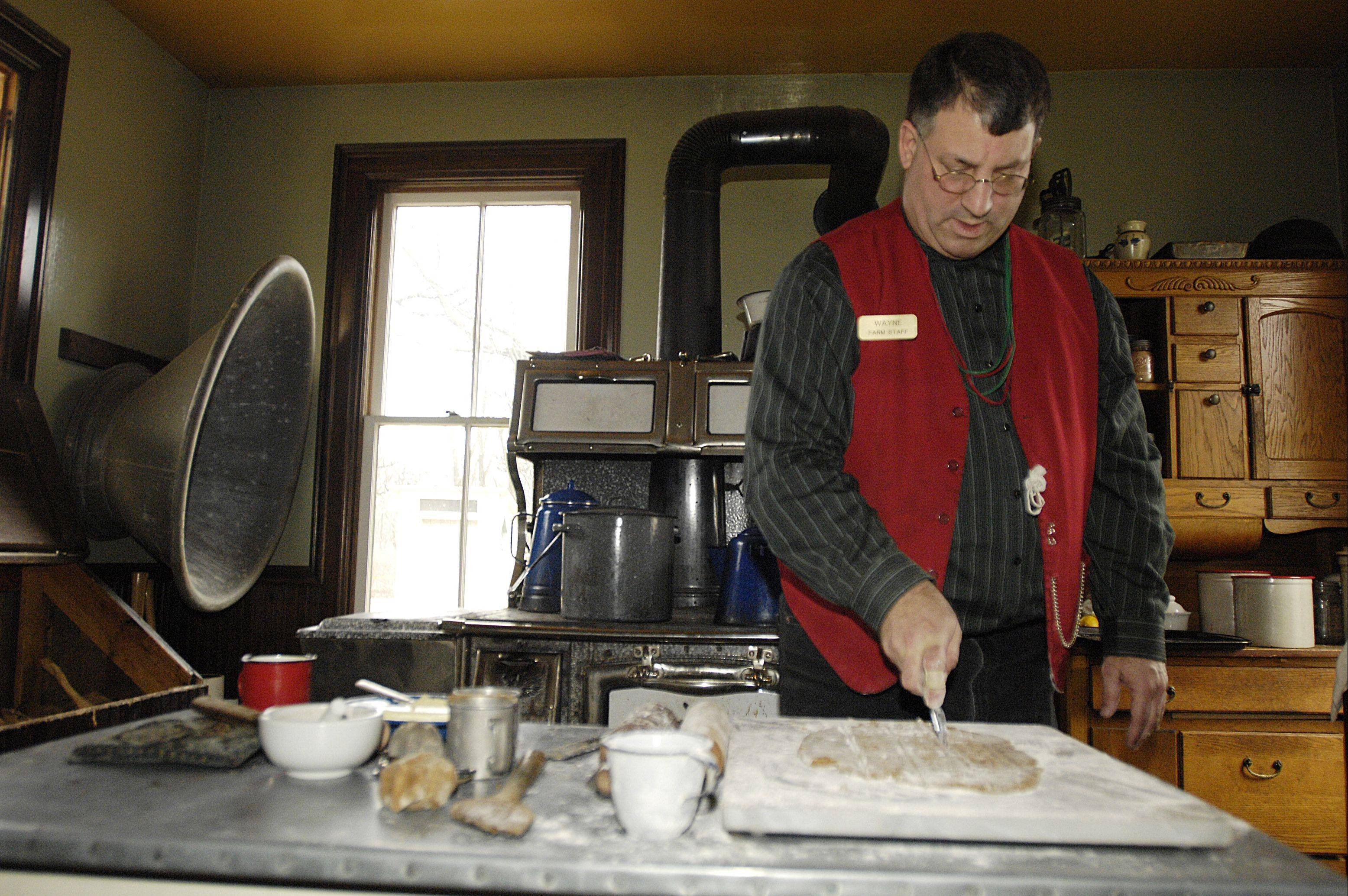 Wayne Hill, a historic interpreter at Kline Creek Farm in West Chicago, makes Christmas cookies in the traditional 1890s way Sunday. It was part of a historical interpretation of what Christmas was like in the 1890s in DuPage County.