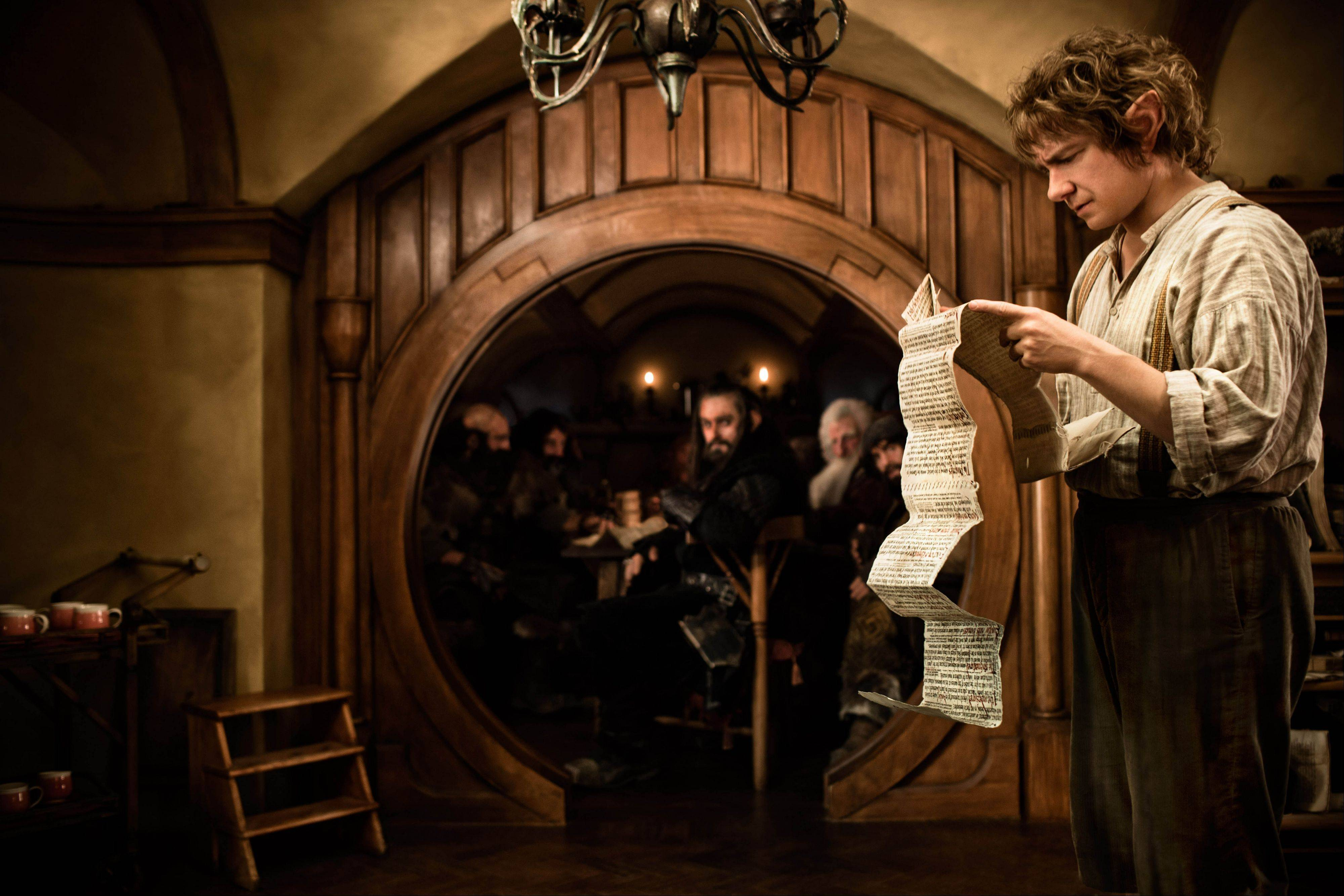 "This publicity film image released by Warner Bros., shows Martin Freeman as Bilbo Baggins in a scene from the fantasy adventure ""The Hobbit: An Unexpected Journey."" ""The Hobbit"" made nearly $90 million in its first weekend of release in the U.S. breaking the previous record set by ""I Am Legend"" starring Will Smith."