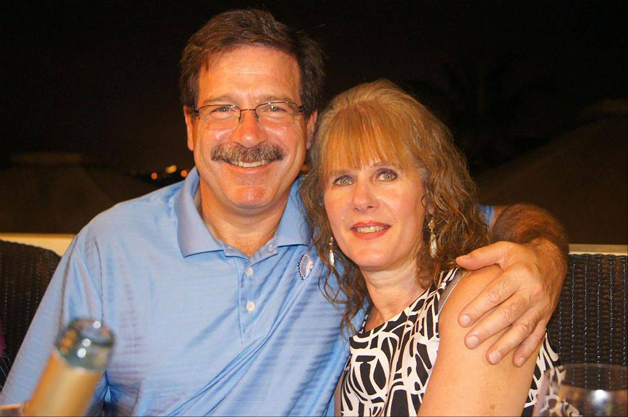 Mark Sherlach and his wife, school psychologist Mary Sherlach, pose for a photo. Mary Sherlach was killed by the gunman at Sandy Hook Elementary School in Newtown, Conn., Friday.