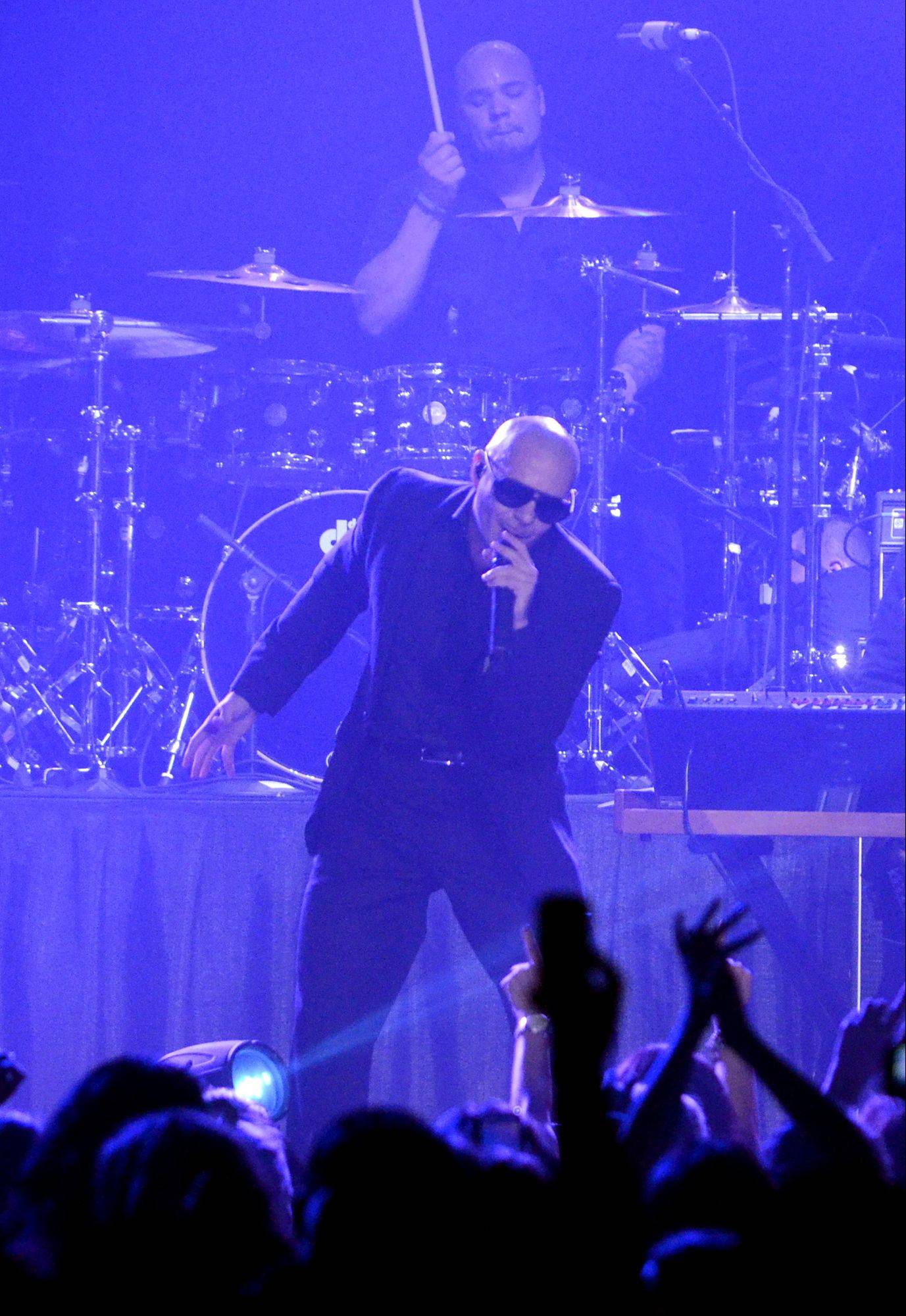 Pitbull performs during the Jingle Bash concert at the Allstate Arena in Rosemont on Saturday, December 15th, 2012.