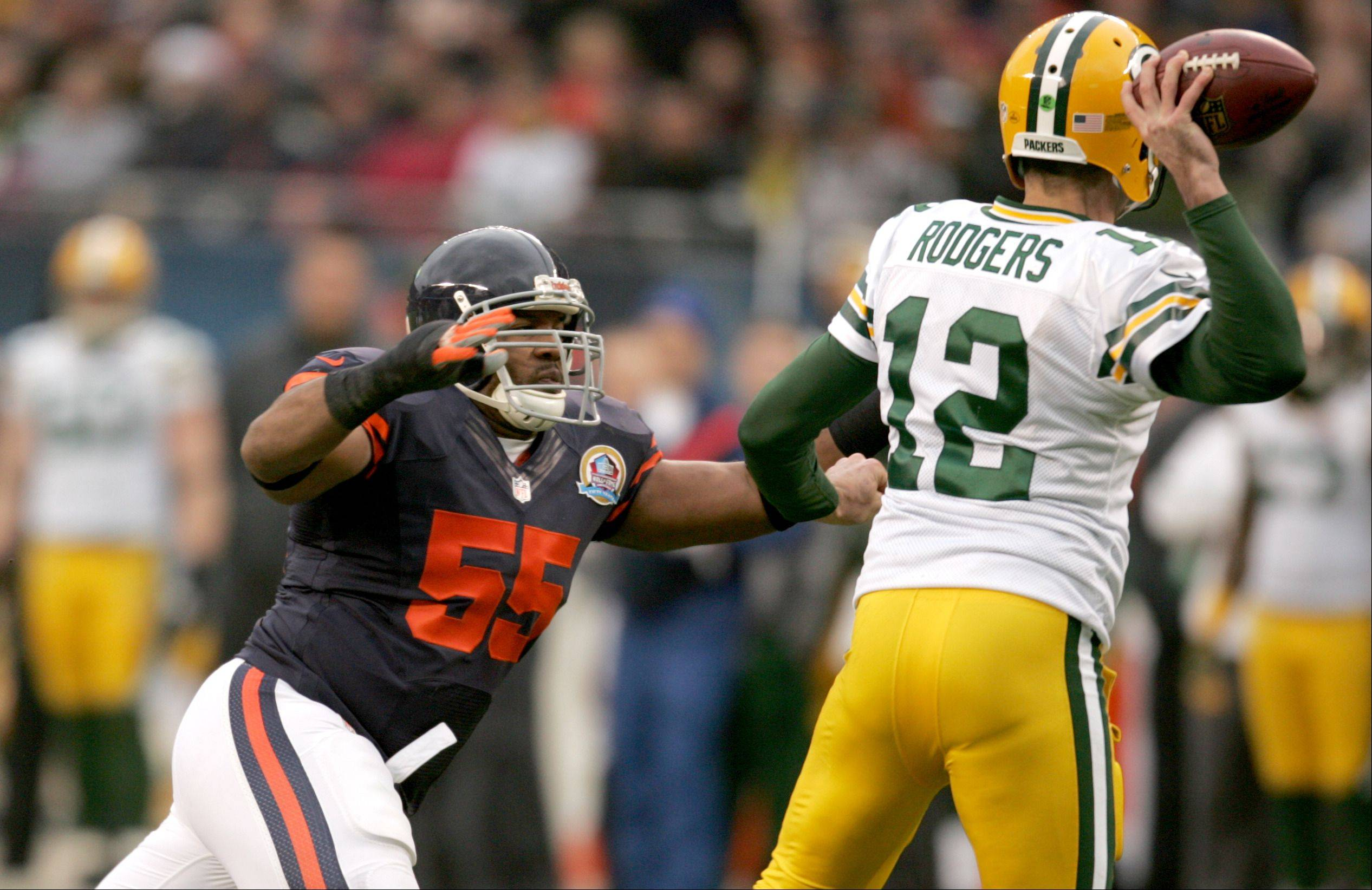 Chicago Bears outside linebacker Lance Briggs (55) tracks down Green Bay Packers quarterback Aaron Rodgers (12) during Sunday's game at Soldier Field in Chicago.