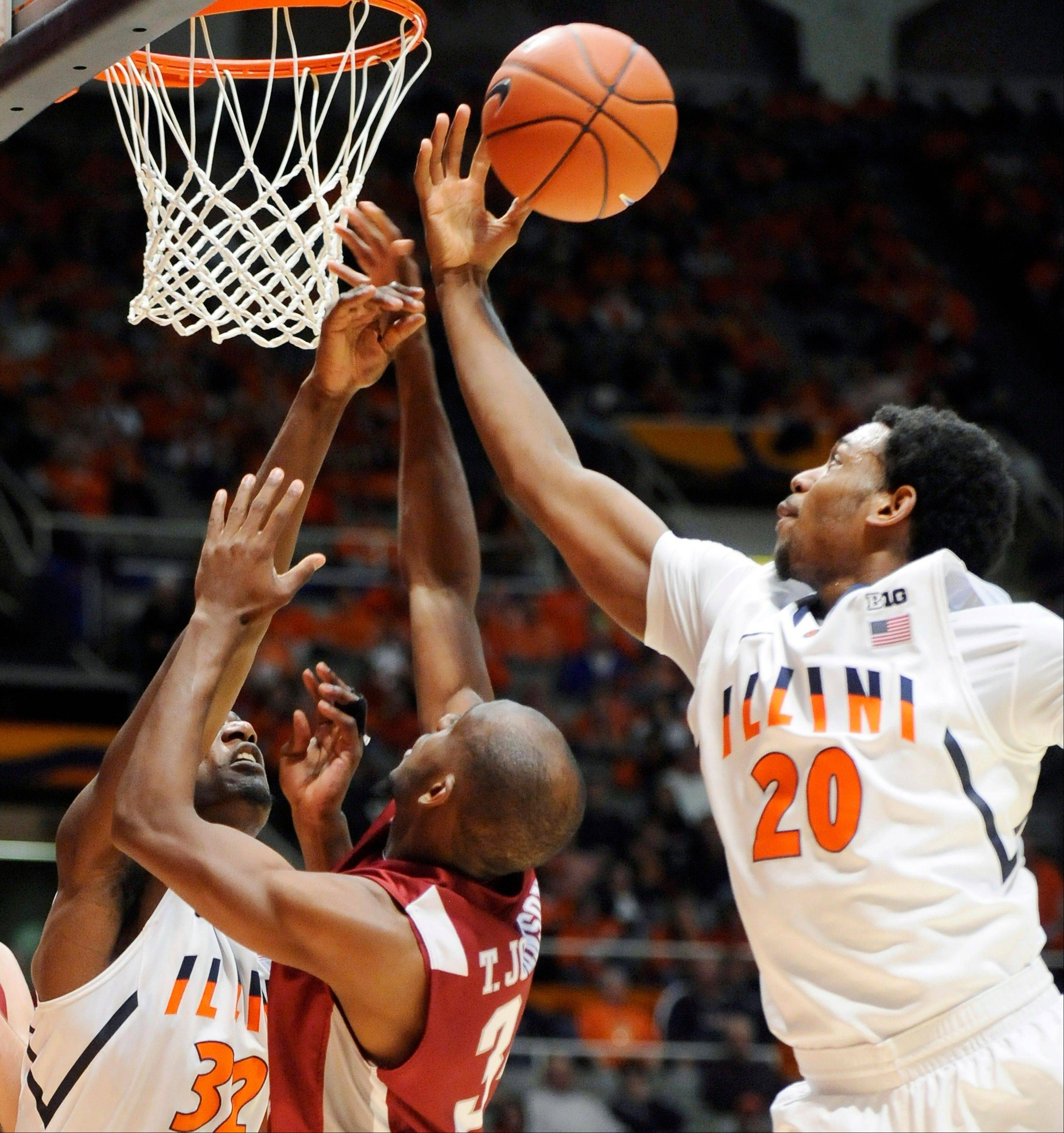Illinois' Myke Henry (20) and Nnanna Egwu (32) fight for possession of the ball with Eastern Kentucky's guard Tarius Johnson (34) in the second half at Assembly Hall in Champaign, Ill., Sunday. Illinois won 66-53.