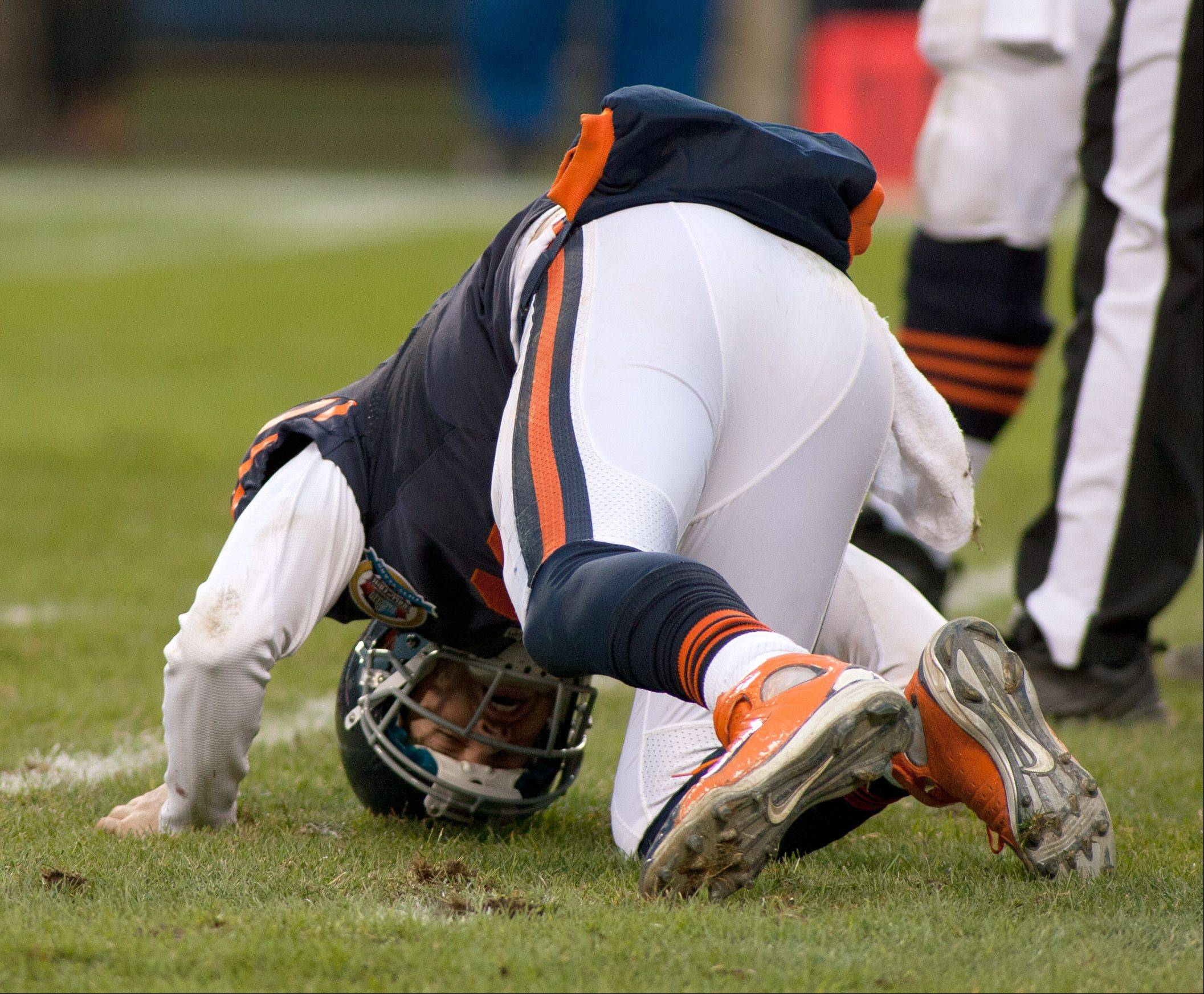 Jay Cutler is slow to get up from the turf following a late fourth quarter Packer sack, during Sunday's game at Soldier Field in Chicago.