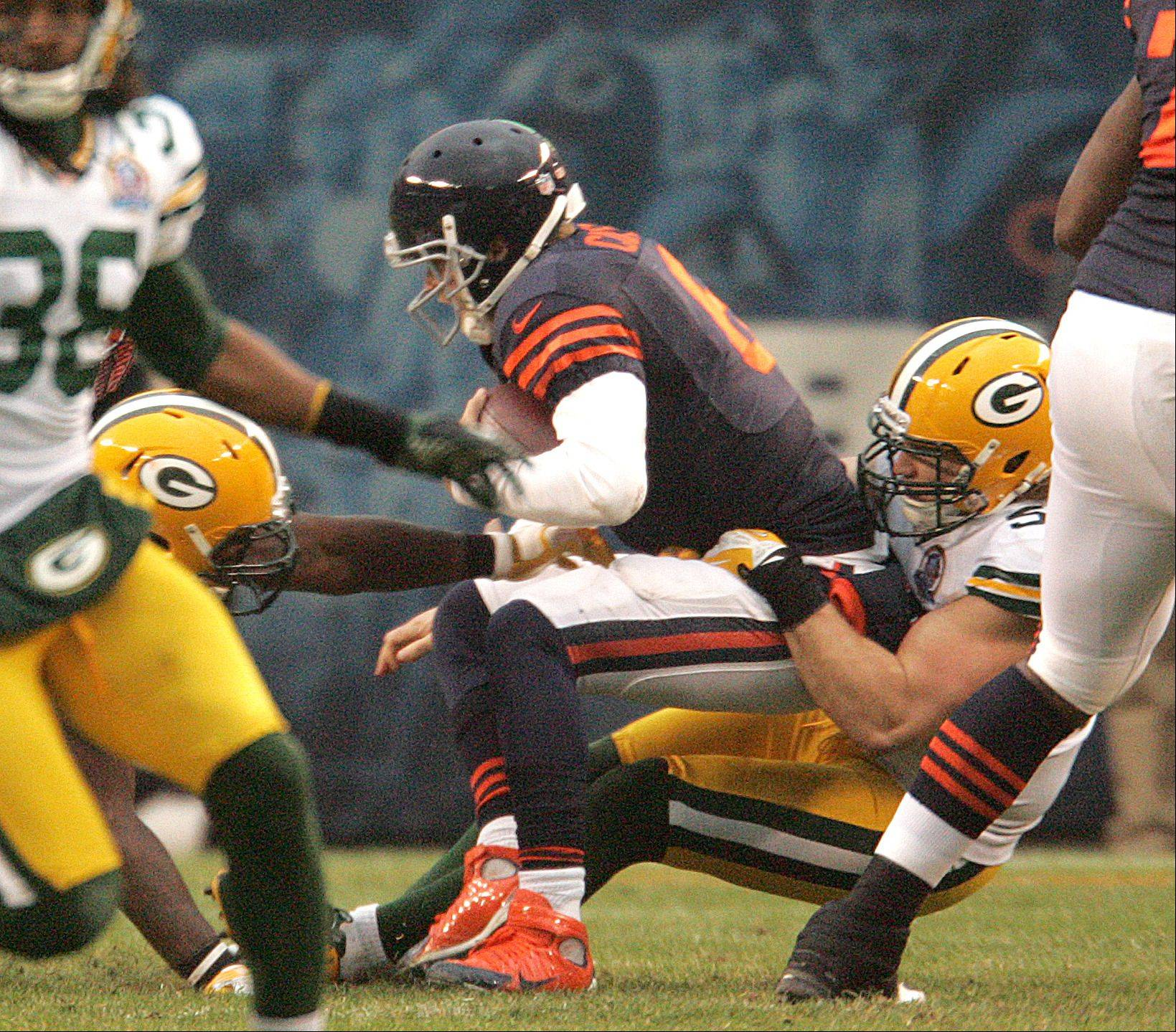 Bears quarterback Jay Cutler (6) is sacked by Green Bay Packers outside linebacker Clay Matthews (52) during Sunday's game at Soldier Field in Chicago.