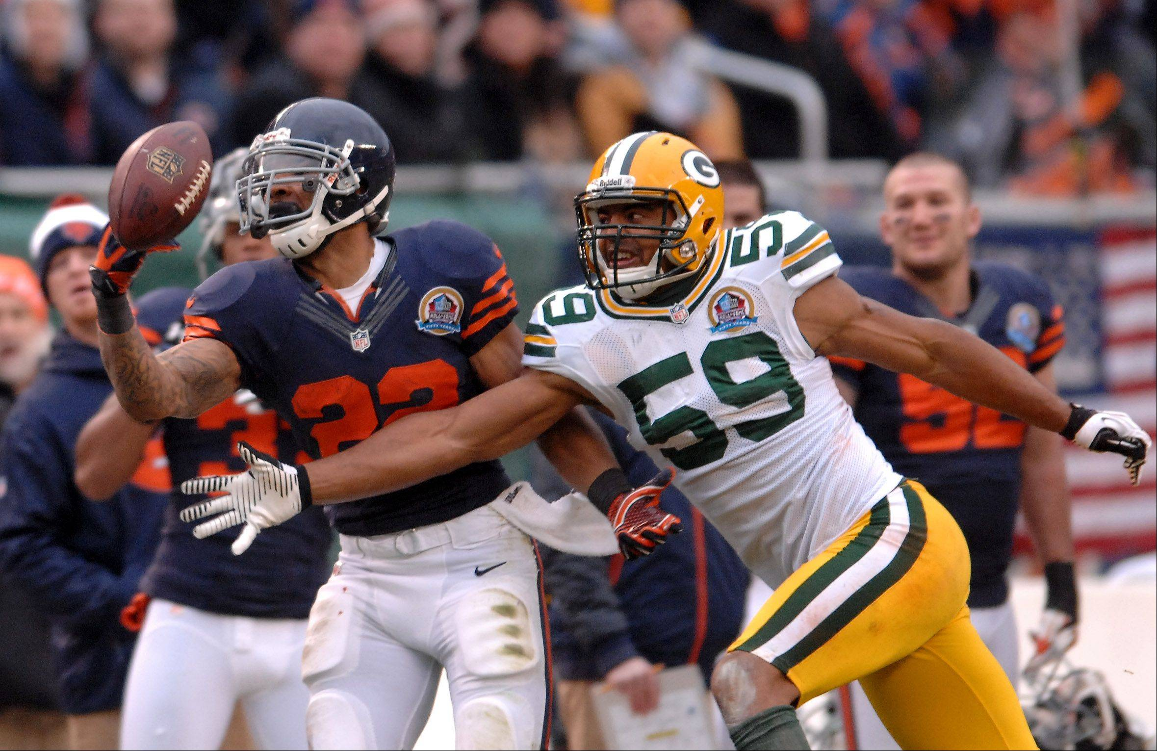 Bears running back Matt Forte (22) can't come up with a catch as Green Bay Packers inside linebacker Brad Jones (59) defends during Sunday's game at Soldier Field in Chicago.