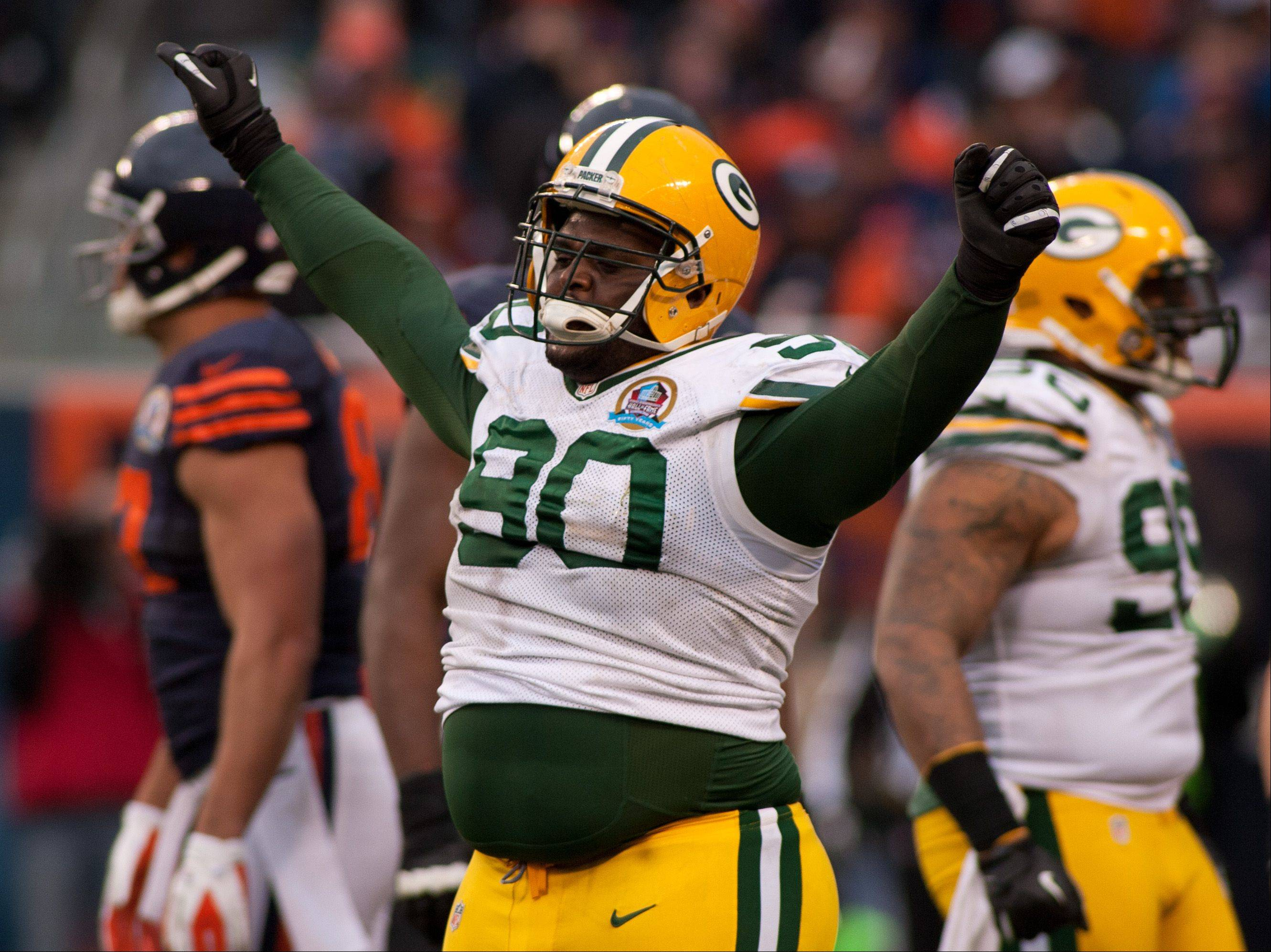 The Packers' B.J. Raji celebrates a goal-line stand, during Sunday's win over the Bears at Soldier Field in Chicago.