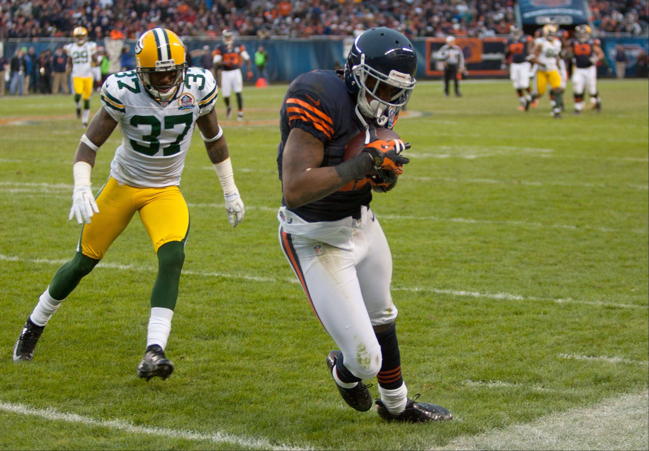 The Bears' Alshon Jeffery, right, makes a late fourth quarter catch, which was whistled back on his own pass interference call, during Sunday's game at Soldier Field in Chicago. At left is the Packer's Sam Shields.