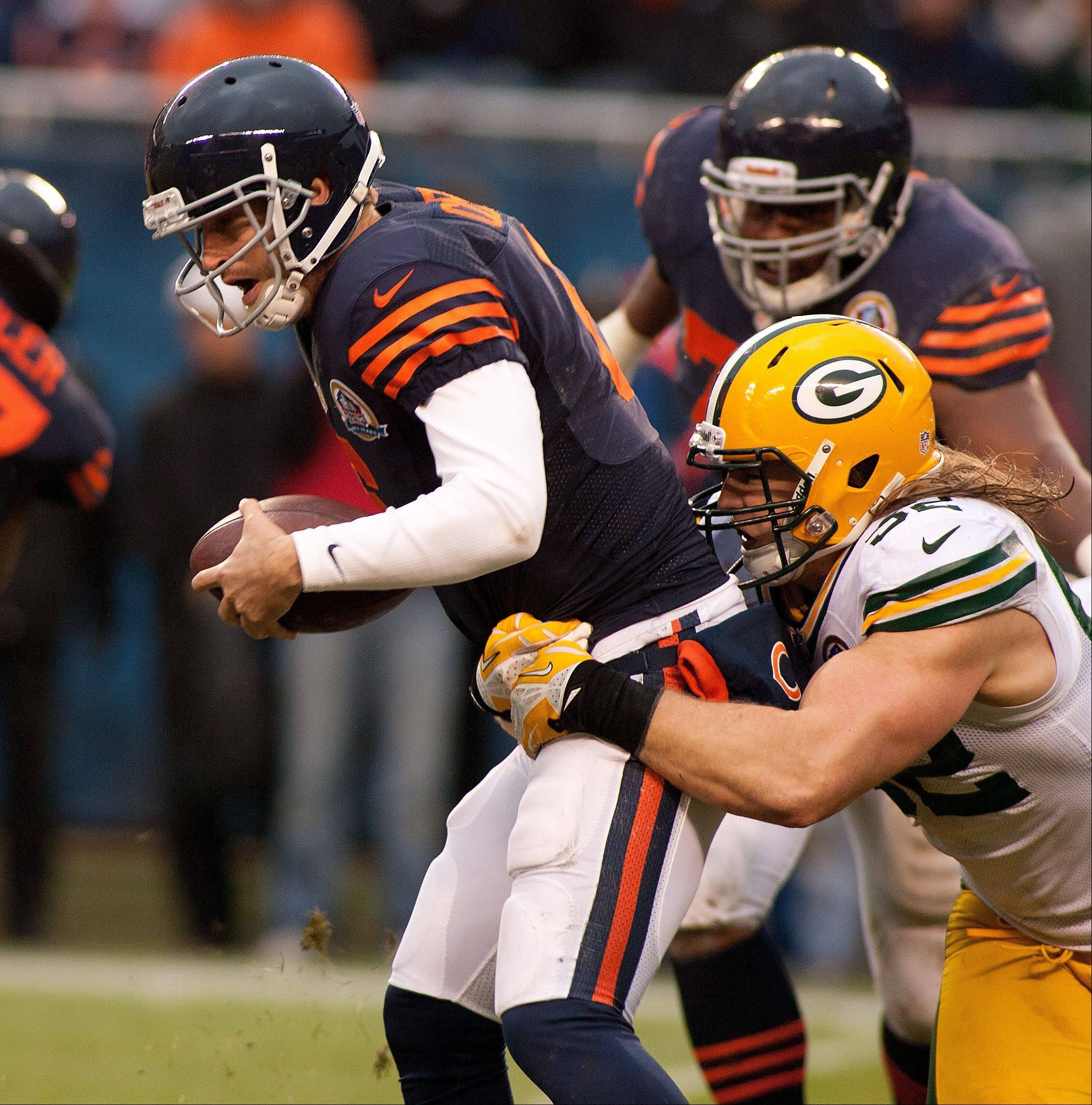 The Bears' Jay Cutler is sacked by the Packer's Clay Mathews, right, late in the fourth quarter during Sunday's game at Soldier Field in Chicago.