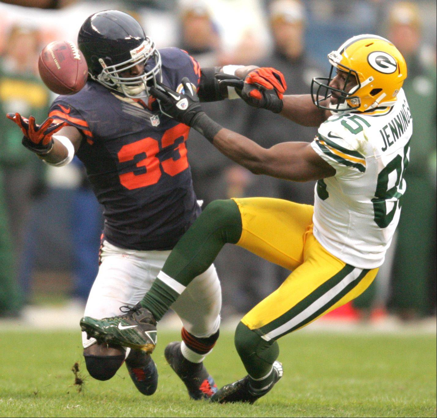 Chicago Bears cornerback Charles Tillman (33), left, and Green Bay Packers wide receiver Greg Jennings (85) get tangled up on a pass from Green Bay Packers quarterback Aaron Rodgers (12) during Sunday's game at Soldier Field in Chicago. The pass fell incomplete.