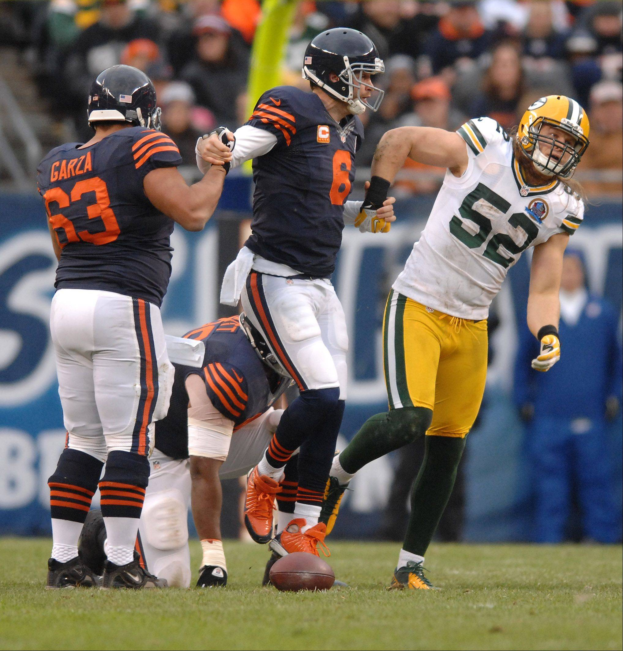 Green Bay Packers outside linebacker Clay Matthews (52) helps up Chicago Bears quarterback Jay Cutler (6) after a sack during Sunday's game at Soldier Field in Chicago.