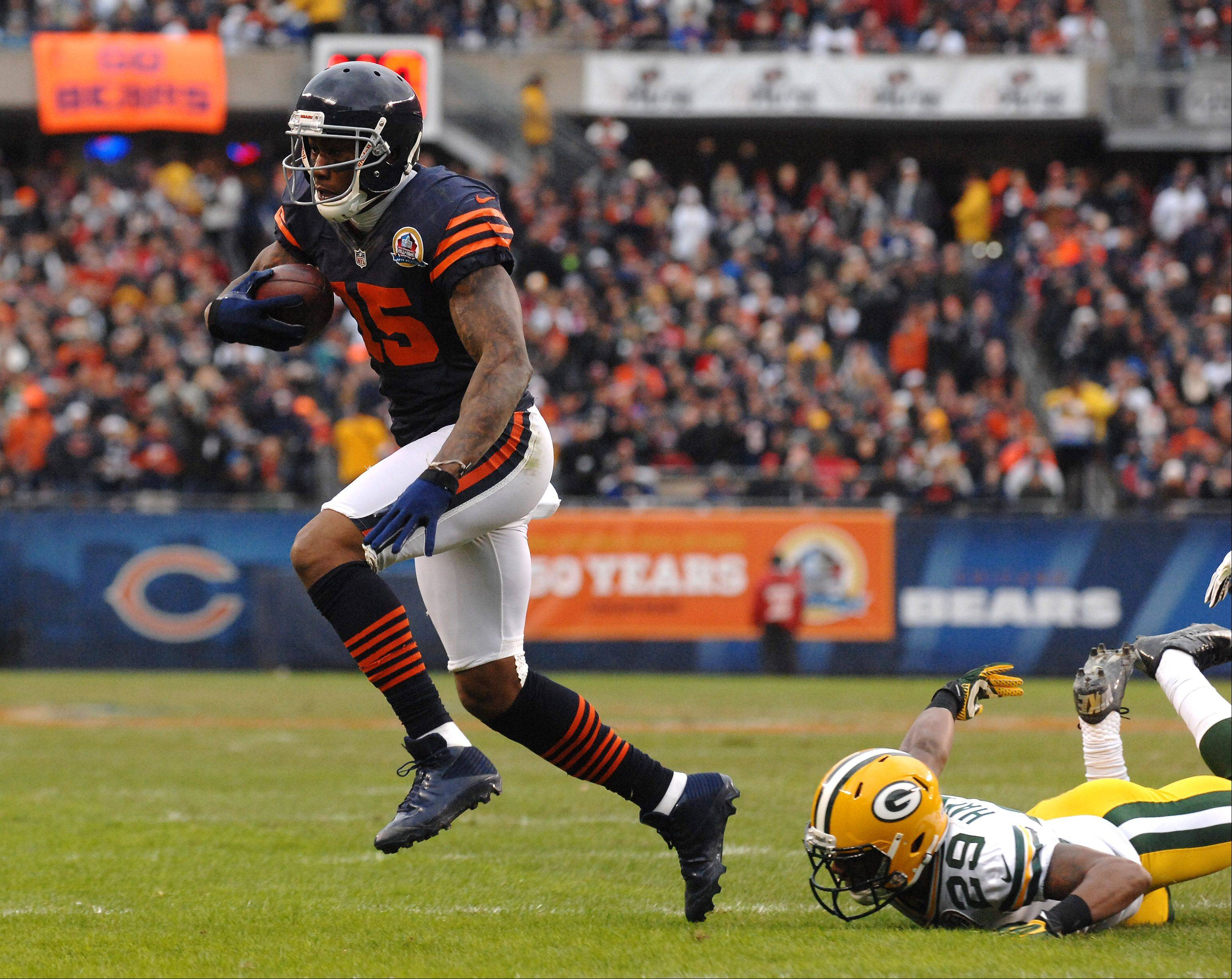 Chicago Bears wide receiver Brandon Marshall (15) gets away from Green Bay Packers cornerback Casey Hayward (29) to score a second-quarter touchdown during Sunday's game at Soldier Field in Chicago.