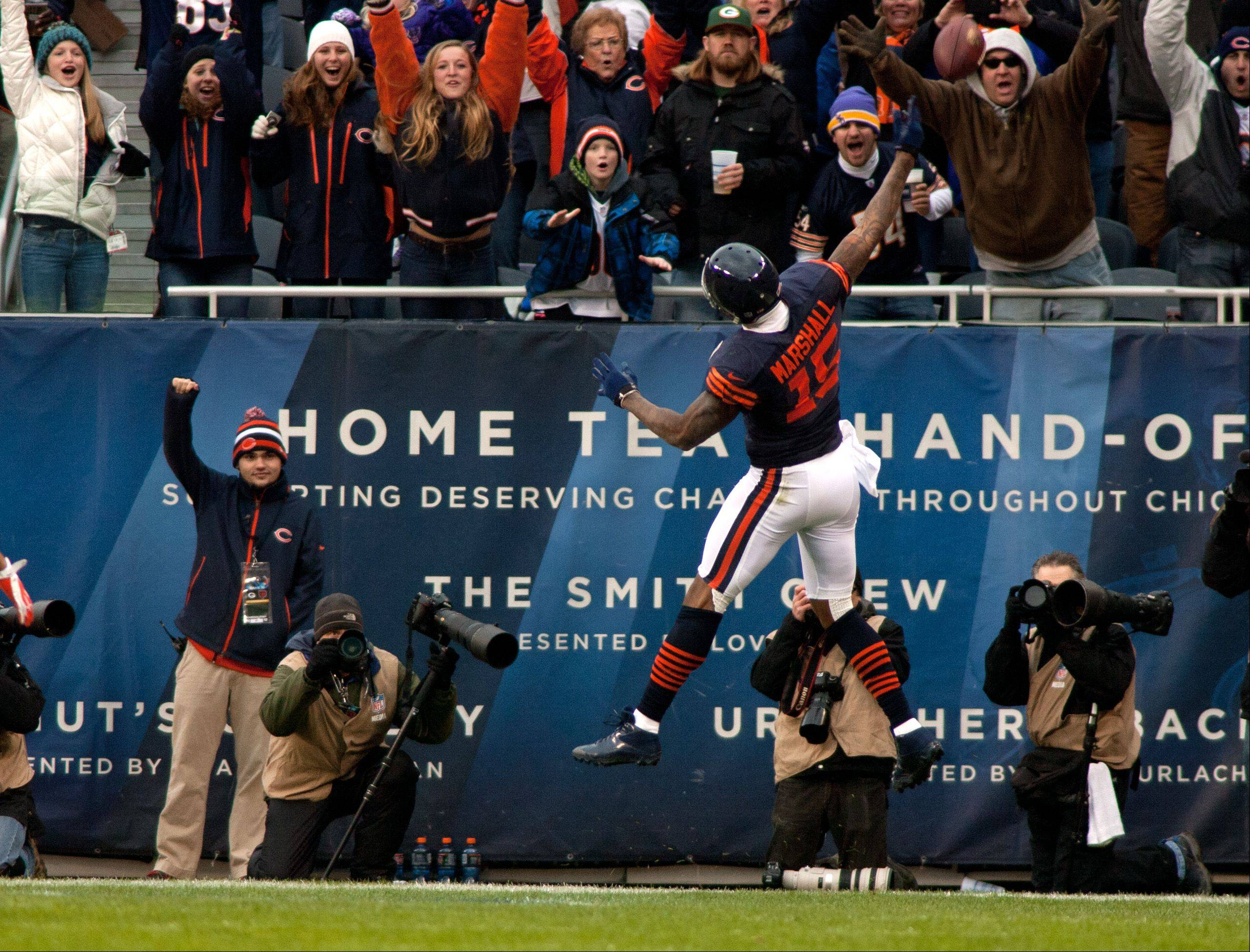 The Bears' Brandon Marshall celebrates his first half touchdown, during Sunday's game at Soldier Field in Chicago.