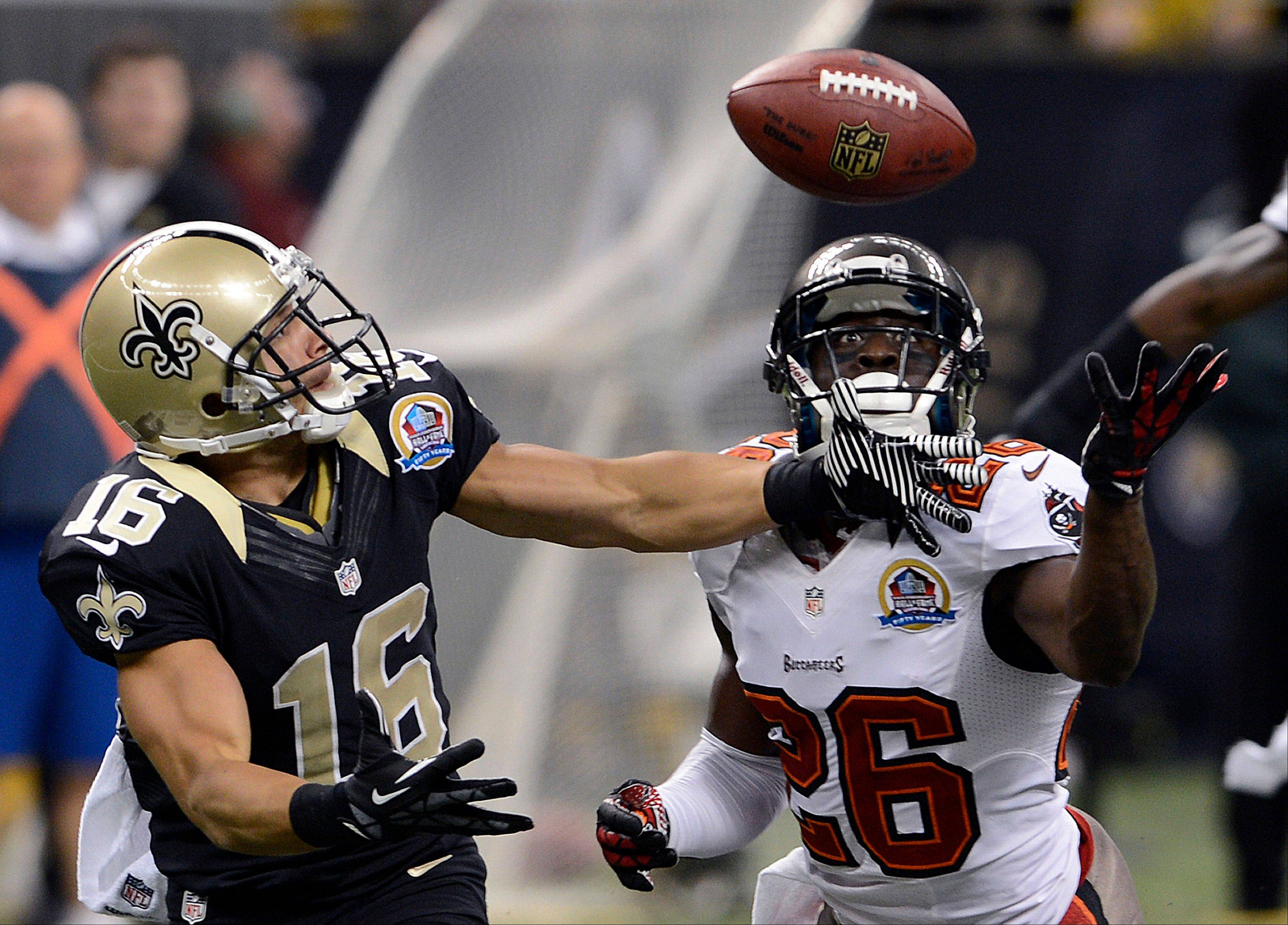 Tampa Bay Buccaneers defensive back Anthony Gaitor (26) breaks up a pass intended for New Orleans Saints wide receiver Lance Moore (16) in the first half at the Mercedes-Benz Superdome in New Orleans, Sunday.