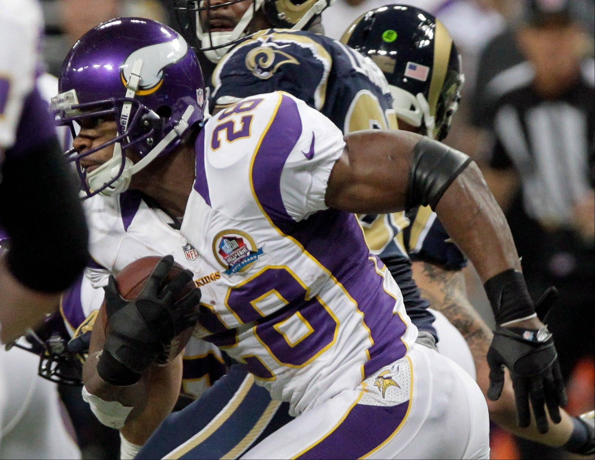 Minnesota Vikings running back Adrian Peterson (28) breaks free for an 82-yard touchdown run during the second quarter against the St. Louis Rams Sunday in St. Louis.
